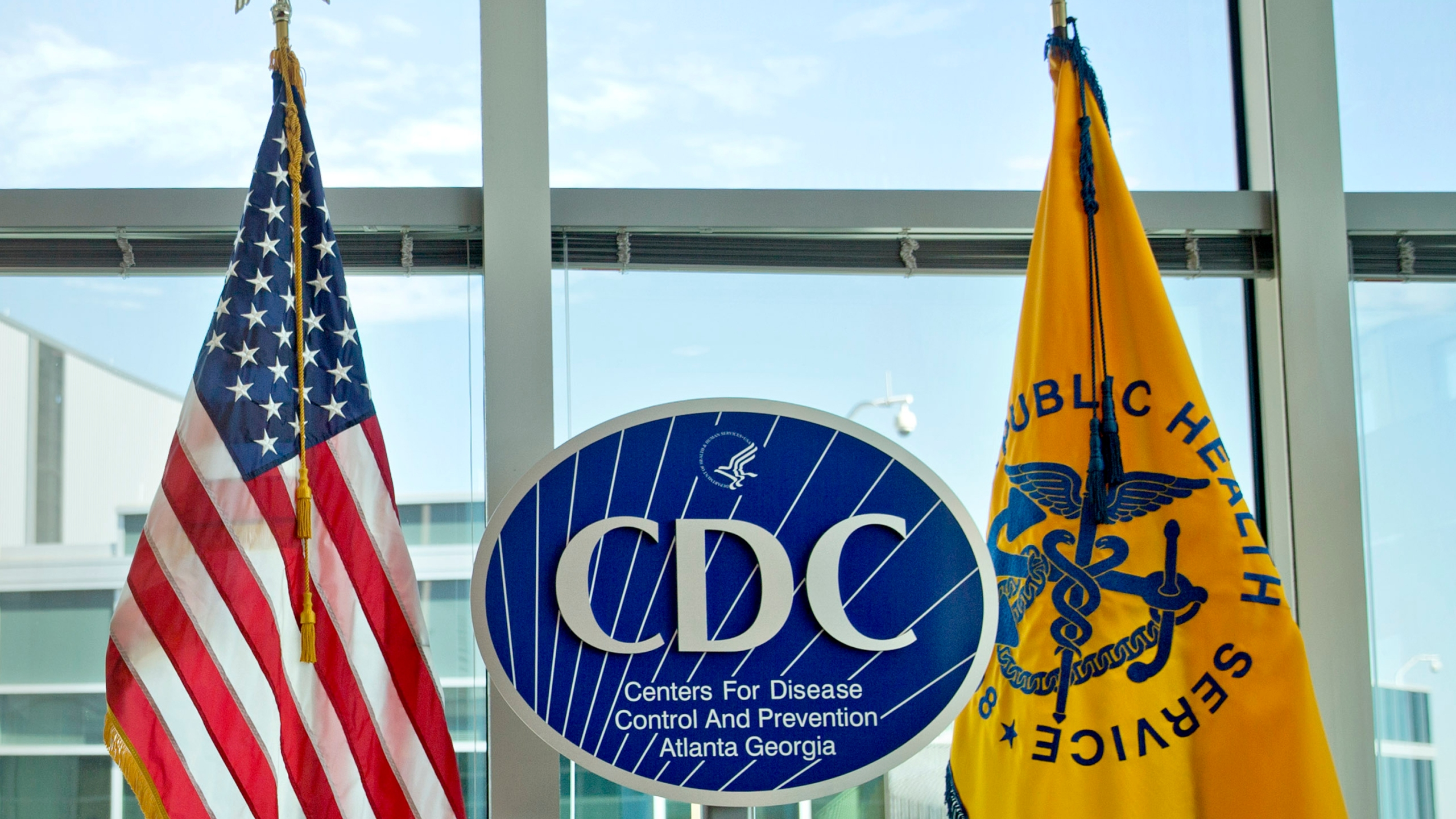 This Nov. 19, 2013 file photo shows a Centers for Disease Control and Prevention logo at the agency's federal headquarters in Atlanta. In a growing medical mystery, a person who died in July 2021 in Georgia has been confirmed as the fourth U.S. case this year of an illness caused by the meliodosis bacteria from South Asia. On Monday, Aug. 9, 2021, the Centers for Disease Control and Prevention sent an alert about the latest case to U.S. doctors. (AP Photo/David Goldman, File)