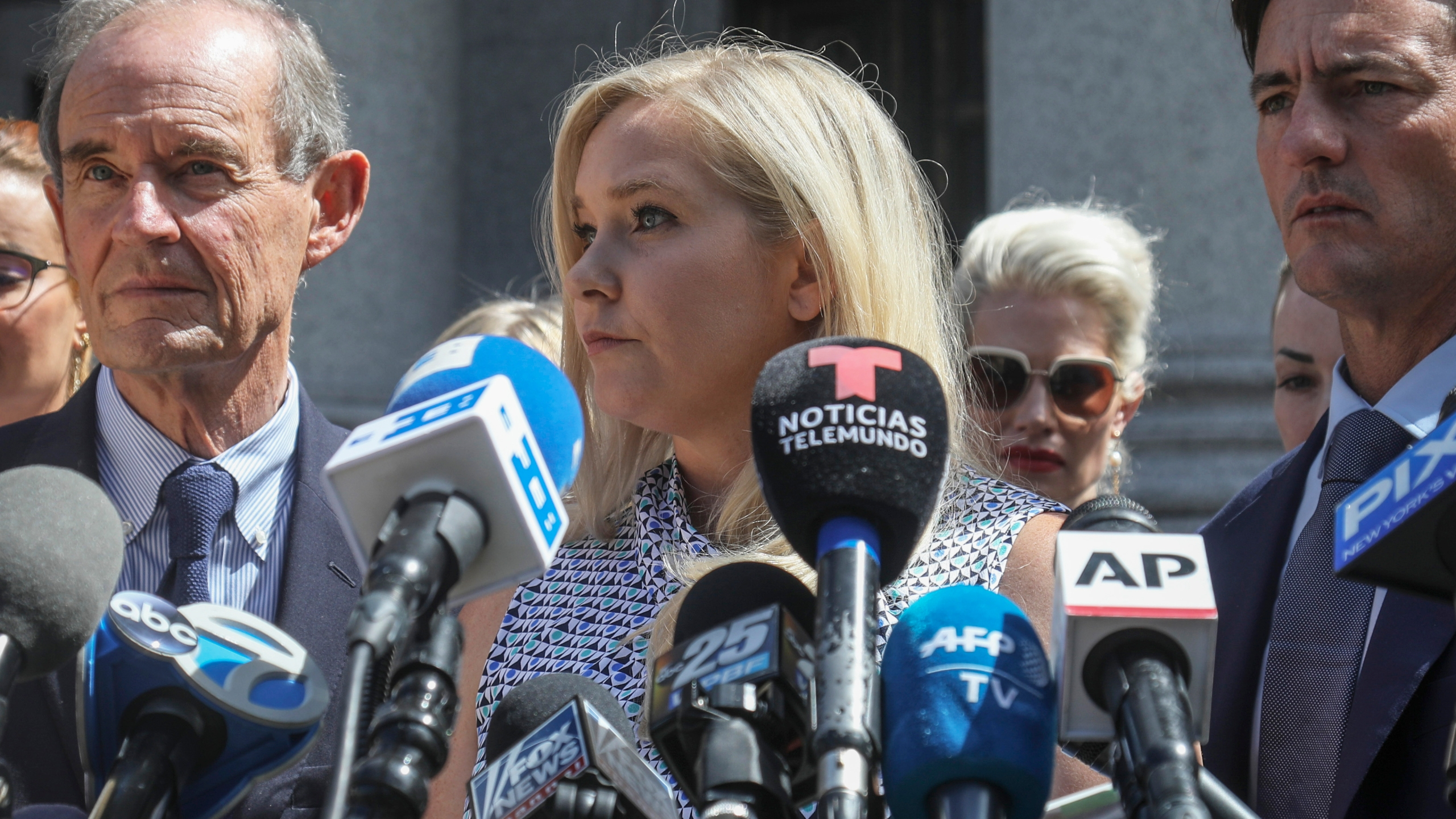 In this Aug. 27, 2019 file photo, Virginia Giuffre, center, who says she was trafficked by sex offender Jeffrey Epstein, holds a news conference outside a Manhattan court in New York. (Bebeto Matthews/AssociatedPress)