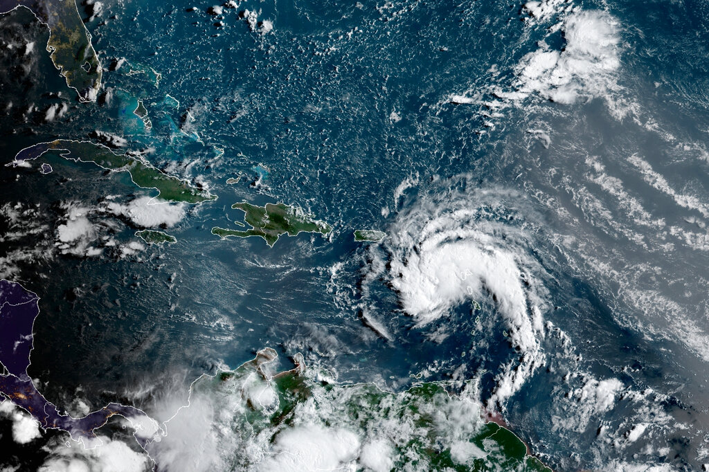 This satellite image provided by the National Oceanic and Atmospheric Administration (NOAA) shows a tropical storm east of Puerto Rico in the Caribbean, at 7:50am EST, Tuesday, Aug. 10, 2021. (NOAA/NESDIS/STAR GOES via AP)