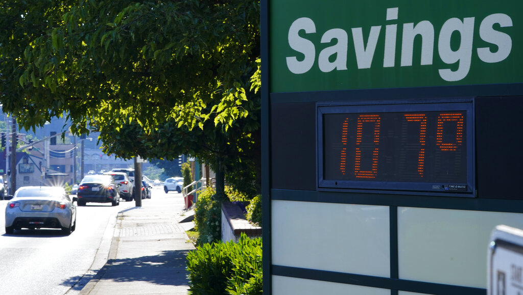 In this June 28, 2021 file photo a display at an Olympia Federal Savings branch shows a temperature of 107 degrees Fahrenheit, in the early evening in Olympia, Wash. (AP Photo/Ted S. Warren, File)