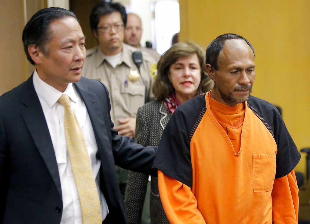 In this July 7, 2015 file pool photo, Juan Francisco Lopez-Sanchez, right, is lead into the courtroom for his arraignment at the Hall of Justice in San Francisco. (Michael Macor/San Francisco Chronicle via AP, File)