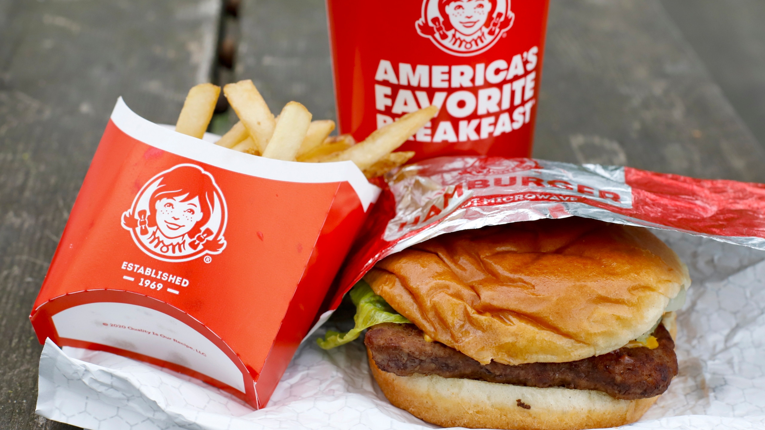 In this May 5, 2020, file photo, Wendy's restaurant Dave's Combo cheeseburger meal is displayed in Pittsburgh. (AP Photo/Gene J. Puskar, File)
