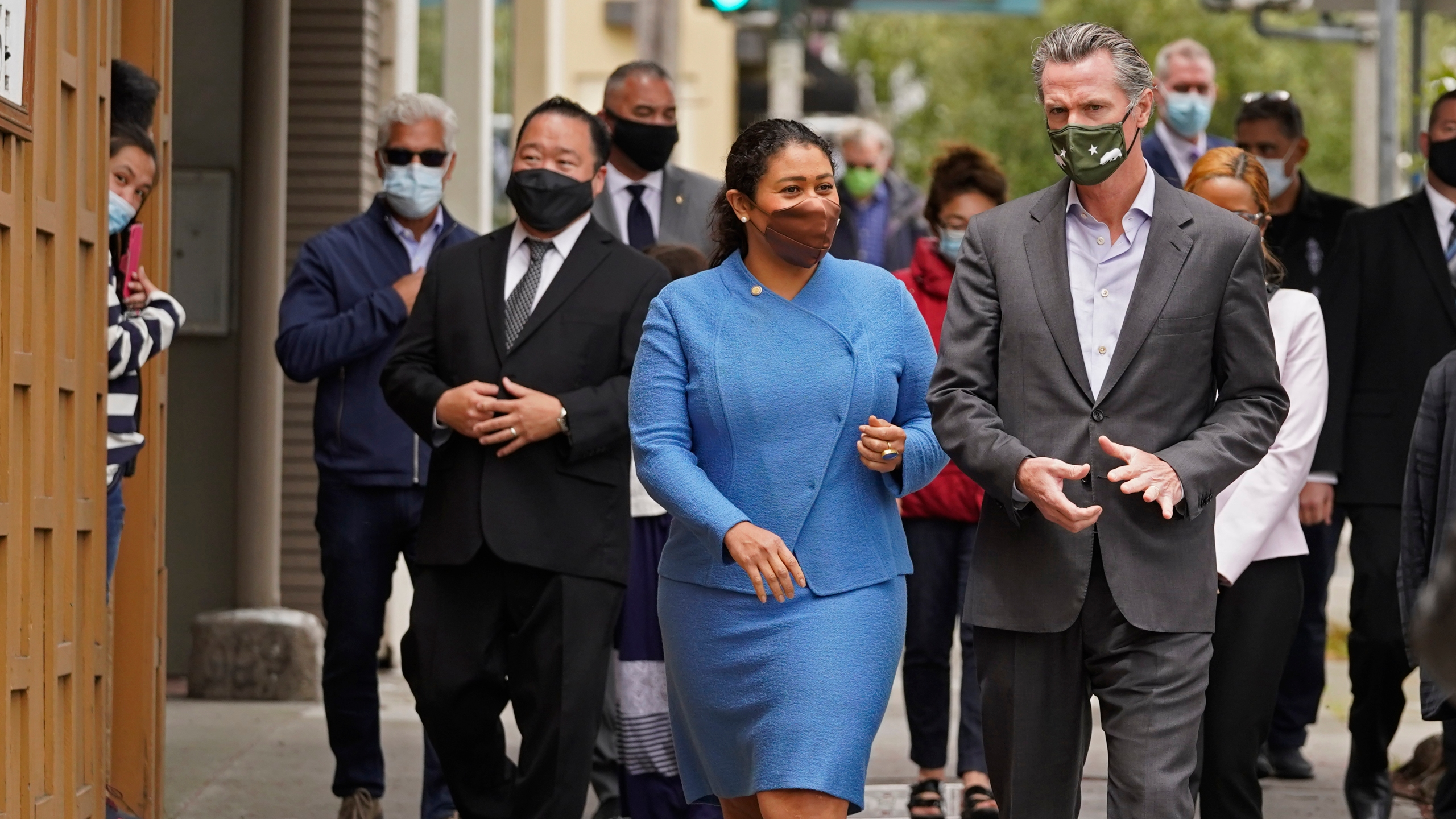 In this June 3, 2021 file photo California Gov. Gavin Newsom walks with San Francisco Mayor London Breed on Geary Street to a news conference outside Tommy's Mexican Restaurant in San Francisco. (Eric Risberg/Associated Press)