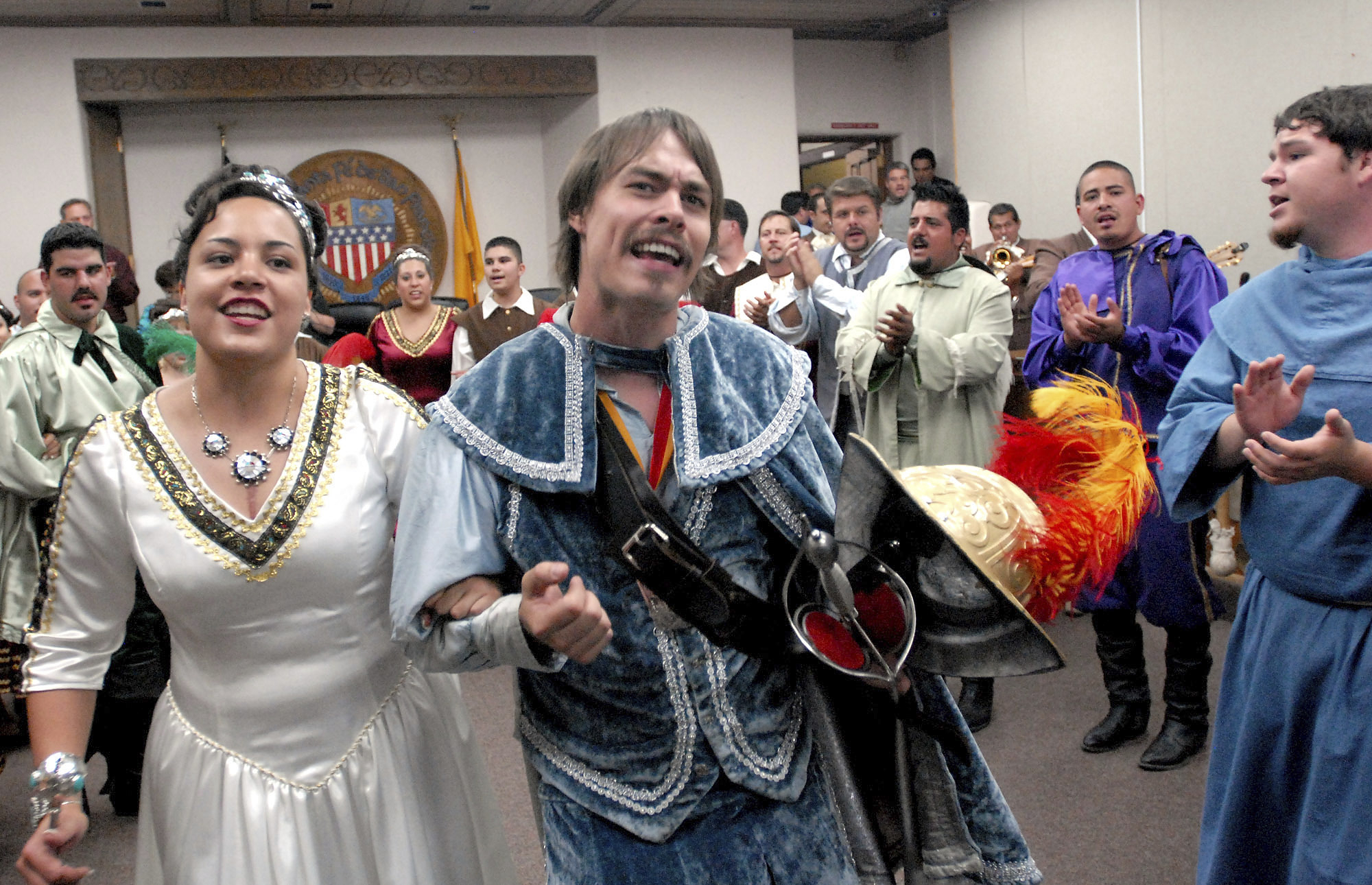 In this Sept. 5, 2006, file photo, Jessica Lucero, left, dressed as the Fiesta Queen, and Jaime Dean, right, dressed as 17th Century Spanish conquistador Don Diego de Vargas, dance and sing at Santa Fe City Hall in Santa Fe, N.M. New Mexico has retained its title as the nation's most heavily Latino state, with 47.7% of respondents to the 2020 census identifying ancestry linked to Latin America and other Spanish-speaking areas. The Census Bureau on Thursday, Aug. 12, 2021 released new demographic details culled from the census. (AP Photo/Jeff Geissler, File)