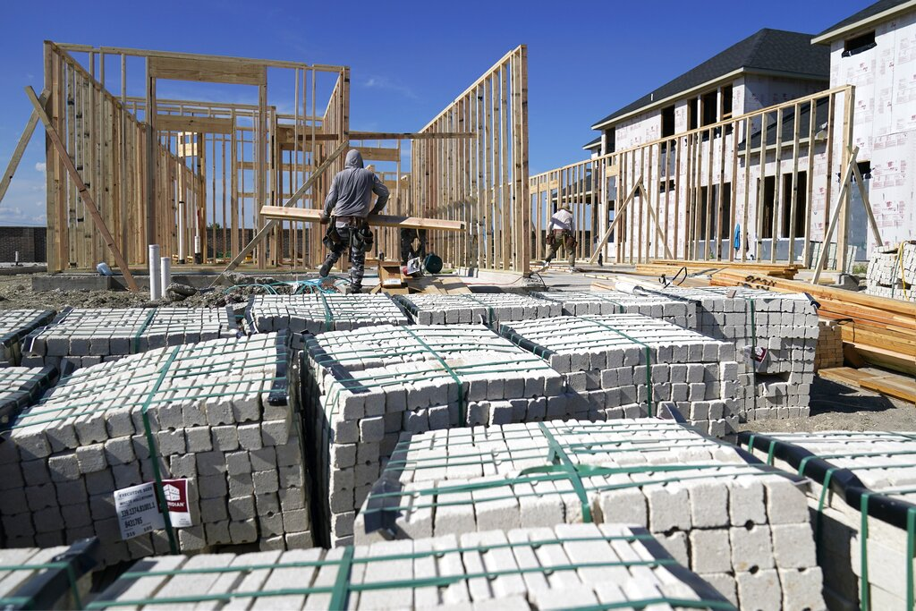 Workers erect the frame of a home being built in a new subdivision in Allen, Texas, Thursday, Aug. 12, 2021. (AP Photo/Tony Gutierrez)