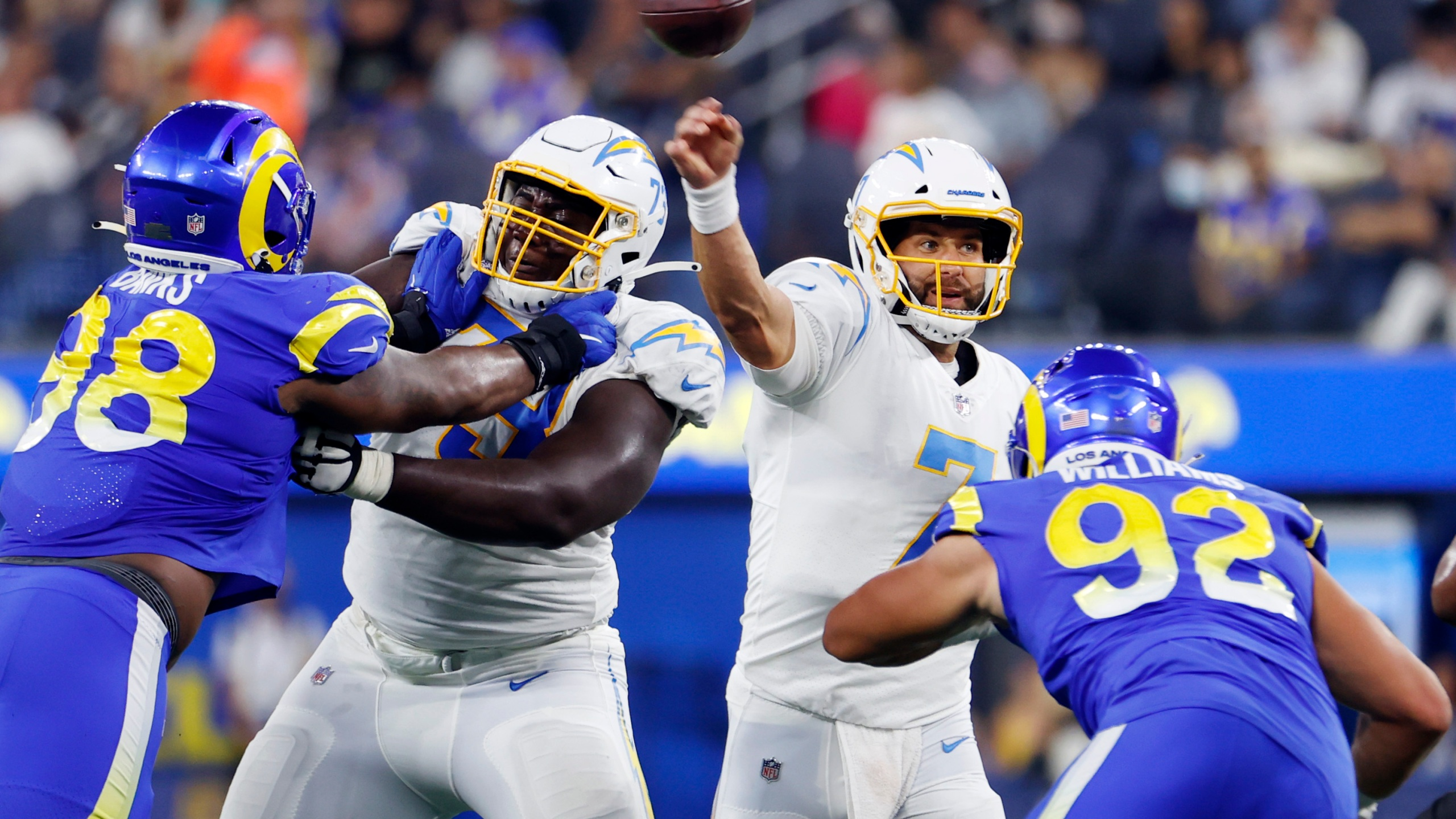 Los Angeles Chargers quarterback Chase Daniel (7) throws a pass against the Los Angeles Rams during the first half of a preseason NFL football game Saturday, Aug. 14, 2021, in Inglewood, Calif. (AP Photo/Ringo H.W. Chiu)