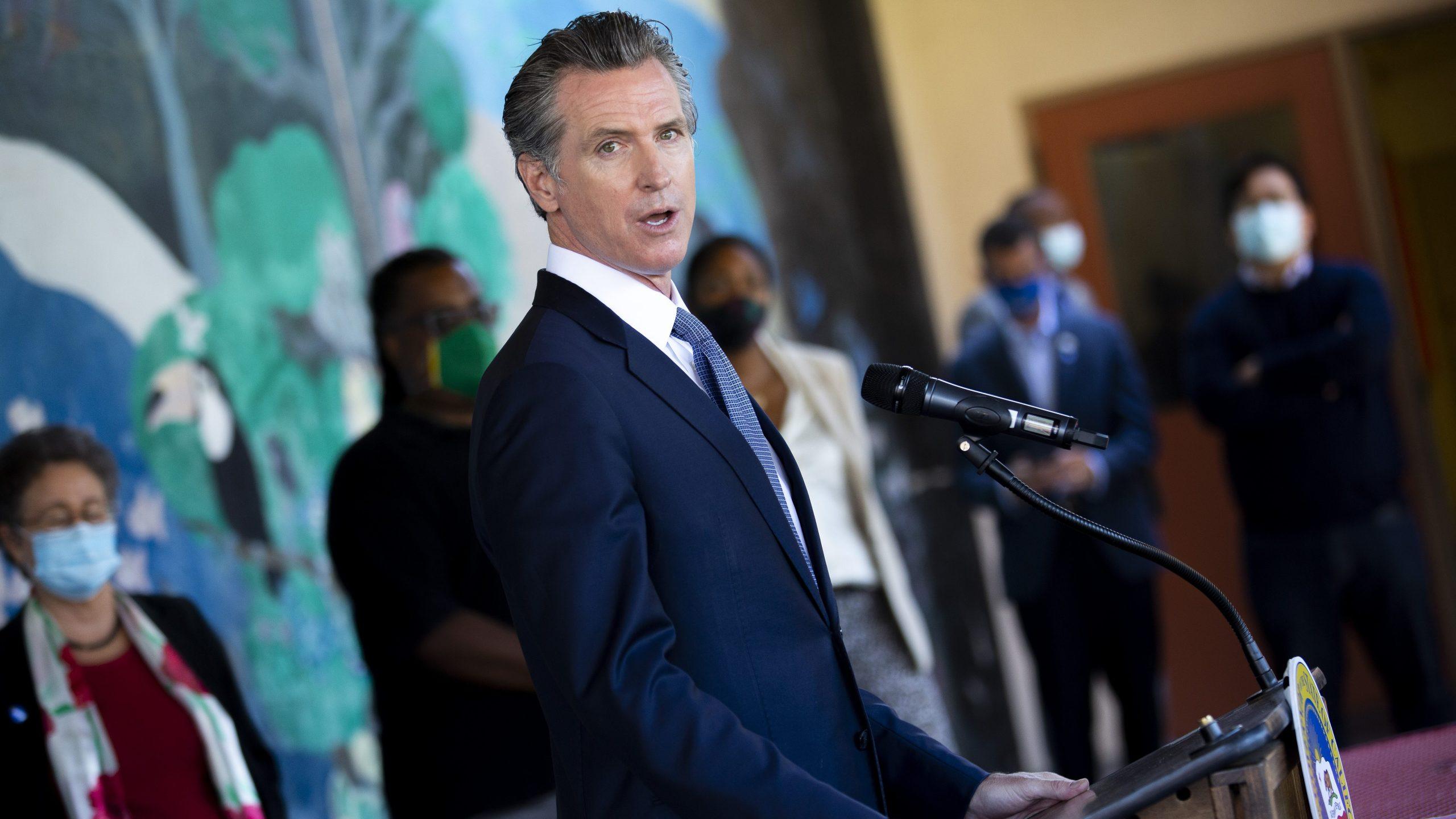 California Gov. Gavin Newsom speaks with reporters at Carl B. Munck Elementary School in Oakland on Aug. 11, 2021. (Santiago Mejia / San Francisco Chronicle via Associated Press)