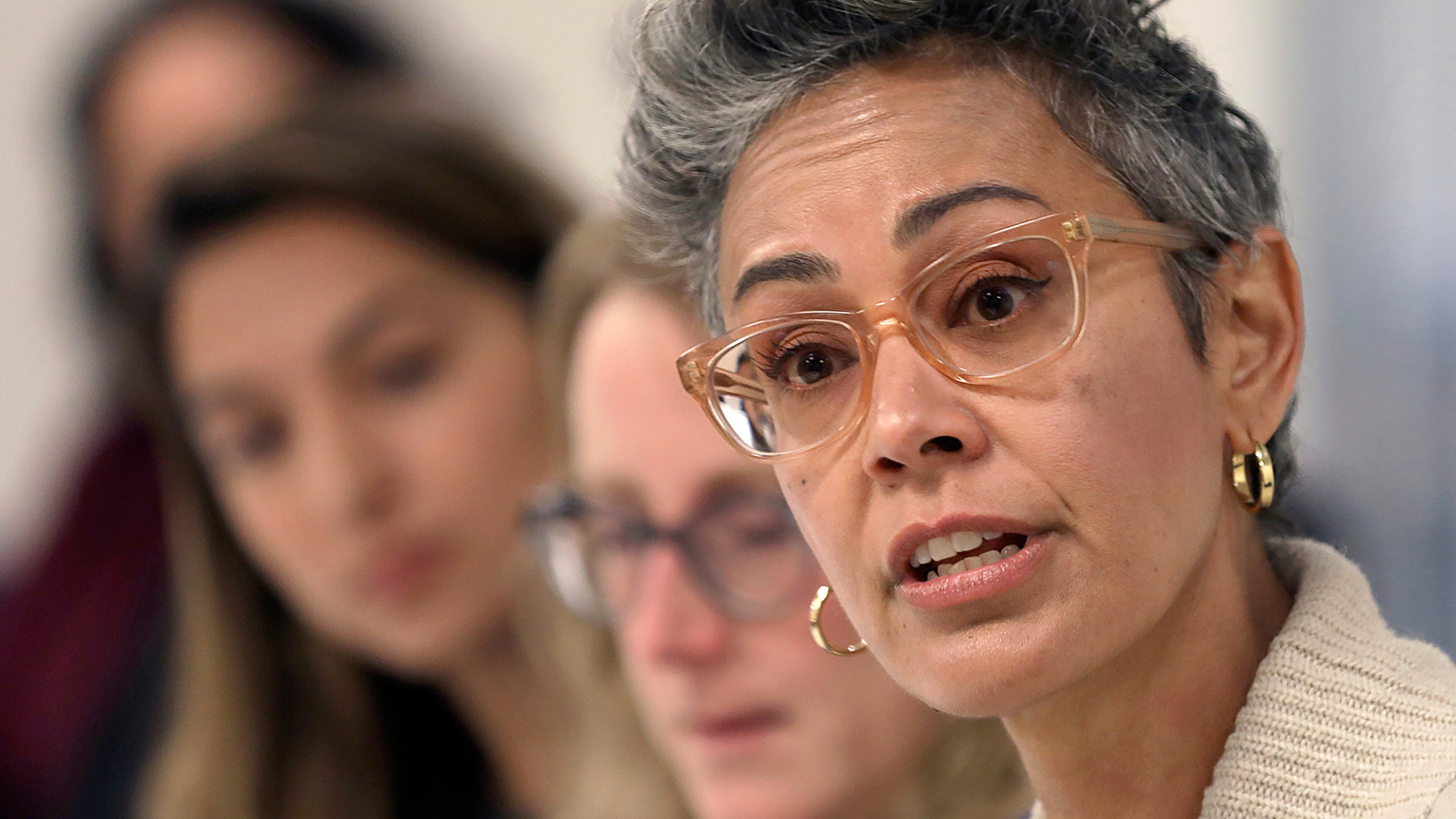 In this Sept. 26, 2018, file photo, Alison Collins, right, speaks during an editorial board meeting in San Francisco. A federal judge threw out an $87 million lawsuit Monday, Aug. 16, 2021, that San Francisco school board member Collins had filed against the district and her colleagues after they voted to strip her of senior board positions because of tweets that were widely criticized as racist. In his ruling, Judge Haywood Gilliam Jr. said the claims by Collins had no merit and there was no need to argue the case in court, the San Francisco Chronicle reported. (Liz Hafalia/San Francisco Chronicle via AP, File)