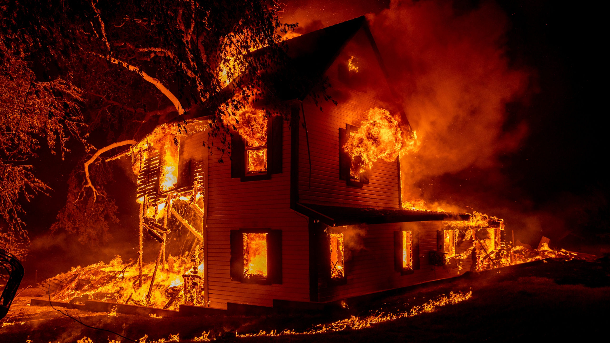 A home burns on Jeters Road as the Dixie Fire jumps Highway 395 south of Janesville, Calif., on Aug. 16, 2021. (Ethan Swope / Associated Press)