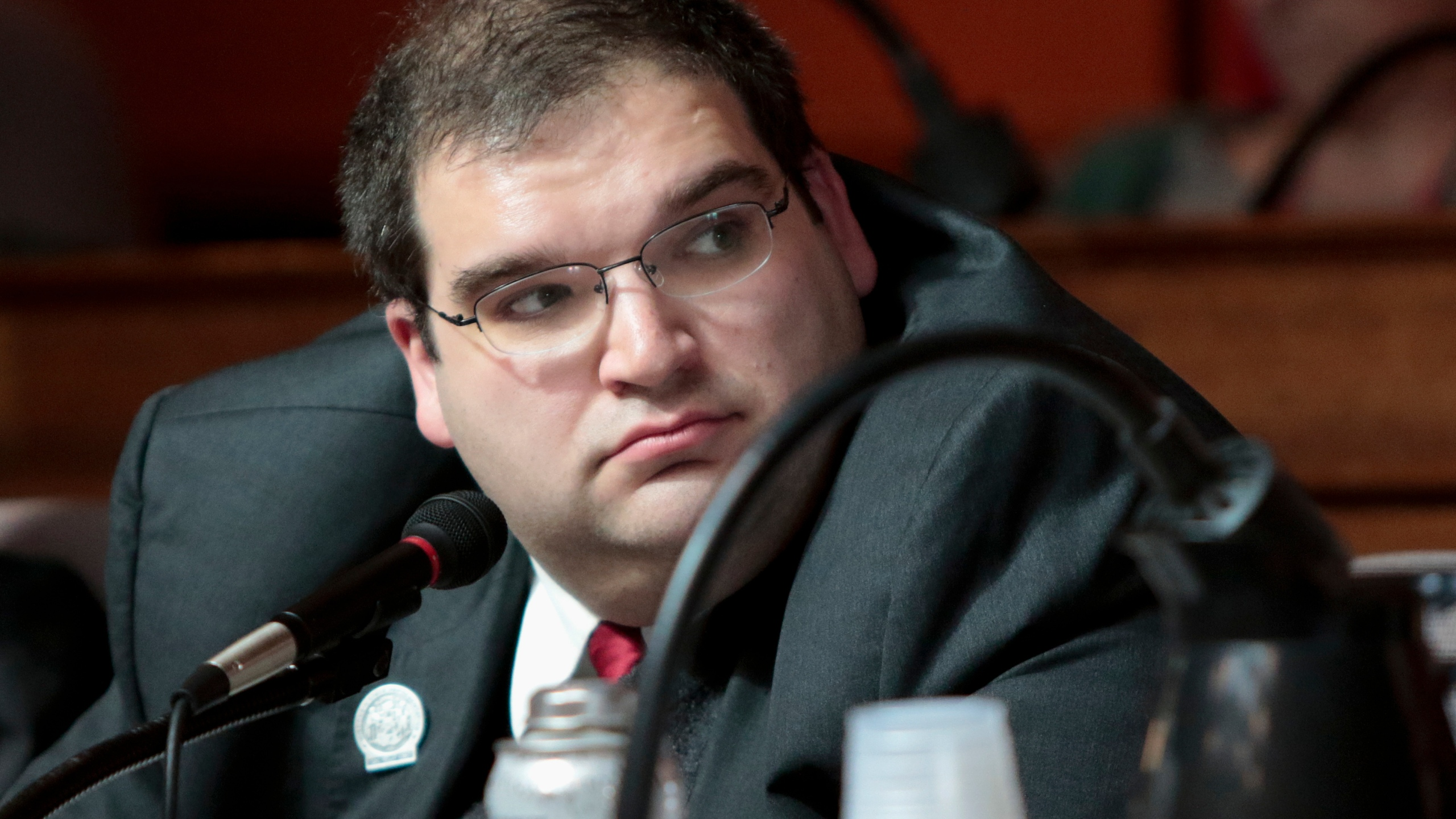 In this March 2, 2015, file photo shows Wisconsin Republican state Rep. Andre Jacques at a labor committee hearing at the State Capitol in Madison, Wis. Jacques, one of the Legislature's most conservative lawmakers and a vocal opponent of mask and vaccine mandates, tested positive for COVID-19 last week and was at the hospital on Monday, Aug. 16, 2021 with pneumonia. (Michael P. King/Wisconsin State Journal via AP, File)