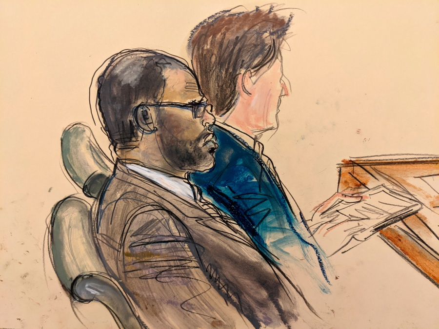 In this courtroom artist's sketch made from a video screen monitor of a Brooklyn courtroom, defendant R. Kelly, left, listens during the opening day of his trial on Aug. 18, 2021, in New York. (AP Photo/Elizabeth Williams)