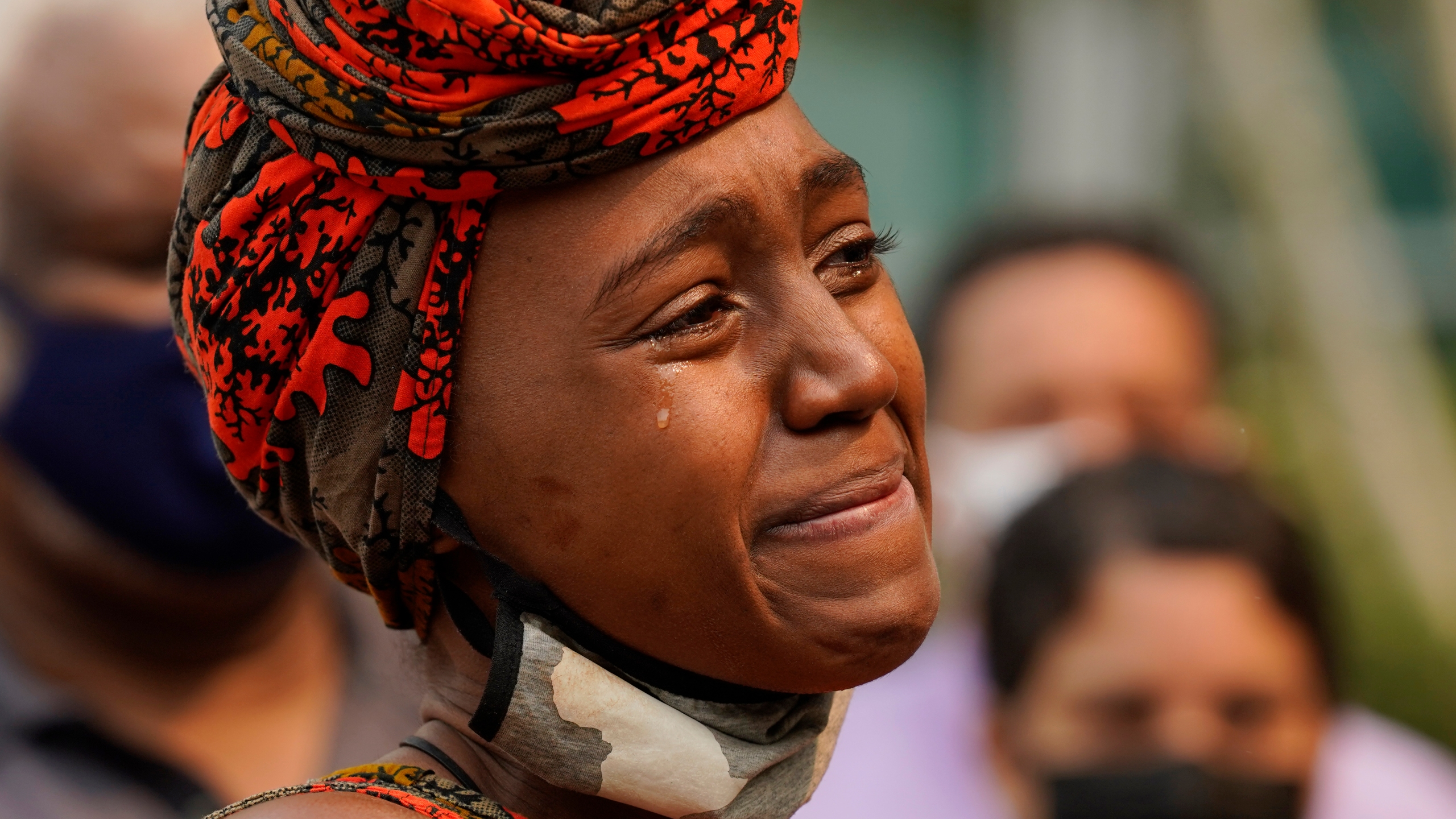 A tear streams down Nakia Porter's cheek during a news conference in Sacramento to announce the filing of a federal lawsuit she has brought against two Solano County Sheriff's deputies on Aug. 18, 2021. (Rich Pedroncelli / Associated Press)