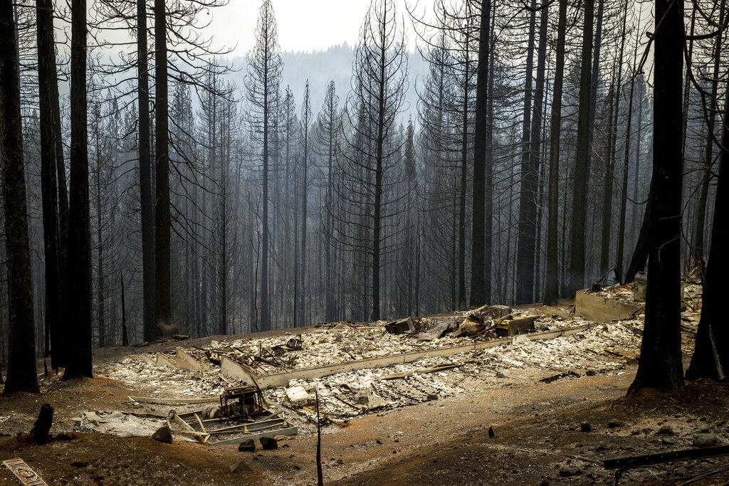Scorched property destroyed by the Caldor Fire is seen in Grizzly Flats, Calif., on Wednesday, Aug. 18, 2021. (AP Photo/Ethan Swope)