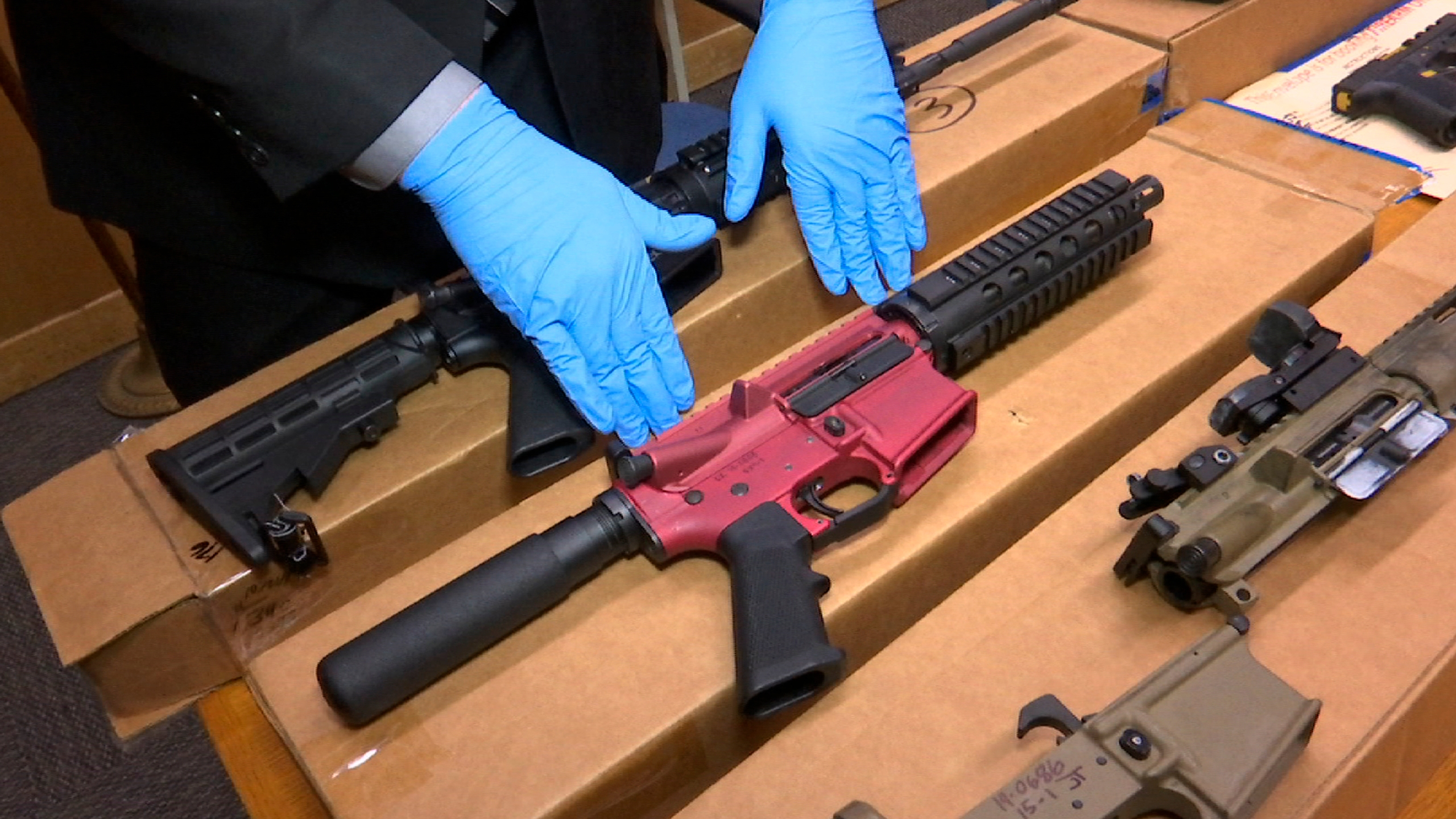 """In this Nov. 27, 2019 file photo, """"ghost guns"""" are displayed at the headquarters of the San Francisco Police Department in San Francisco. (Haven Daley / Associated Press)"""