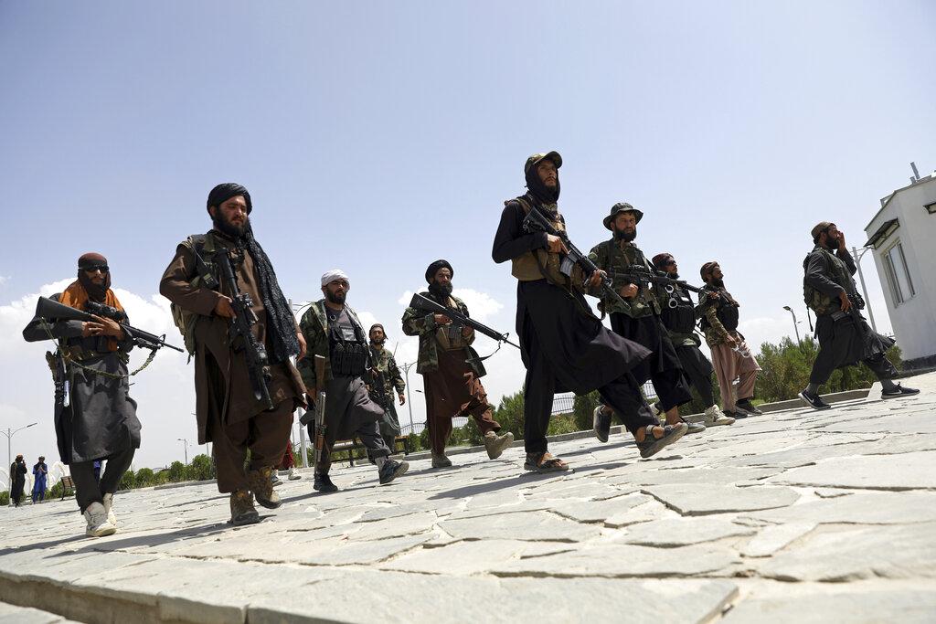 Taliban fighters patrol in Kabul, Afghanistan, Thursday, Aug. 19, 2021. (AP Photo/Rahmat Gul)