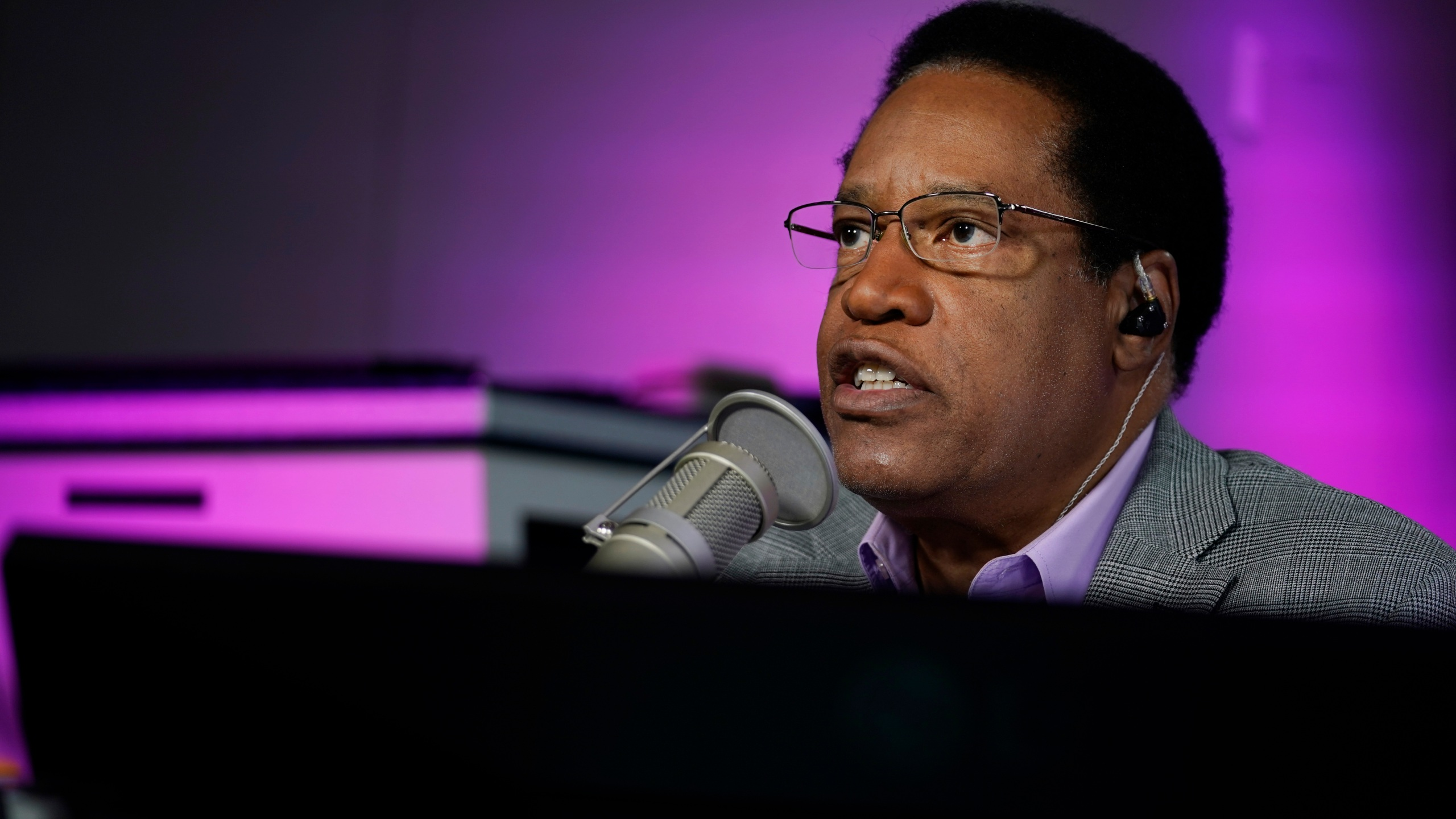 In this July 12, 2021 file photo radio talk show host Larry Elder speaks during his show, in Burbank, Calif. Alexandra Datig, Elder's former fiancee said Thursday, Aug. 19 that Elder, a candidate for governor in the Sept. 14 recall election, once displayed a gun to her during a heated argument in 2015. Elder said he never brandished a gun at anyone. (AP Photo/Marcio Jose Sanchez, File)