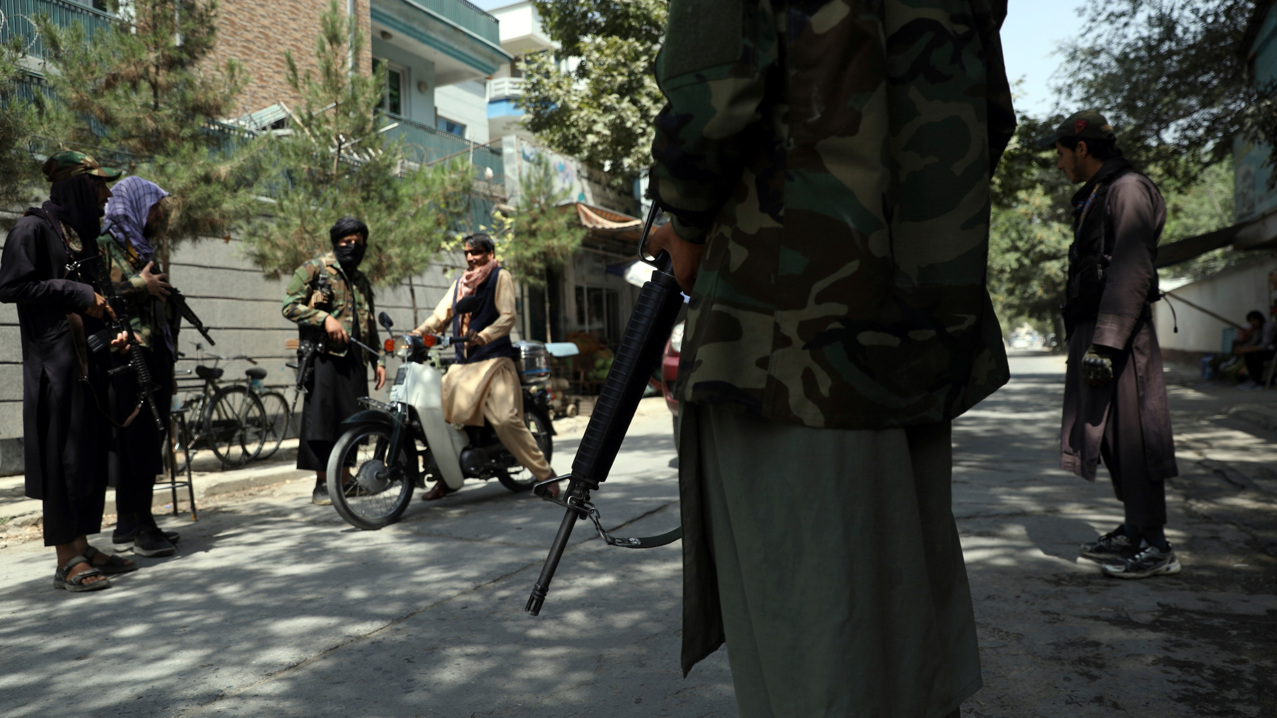 Taliban fighters stand guard at a checkpoint in the Wazir Akbar Khan neighborhood in the city of Kabul, Afghanistan, Sunday, Aug. 22, 2021. (AP Photo/Rahmat Gul)