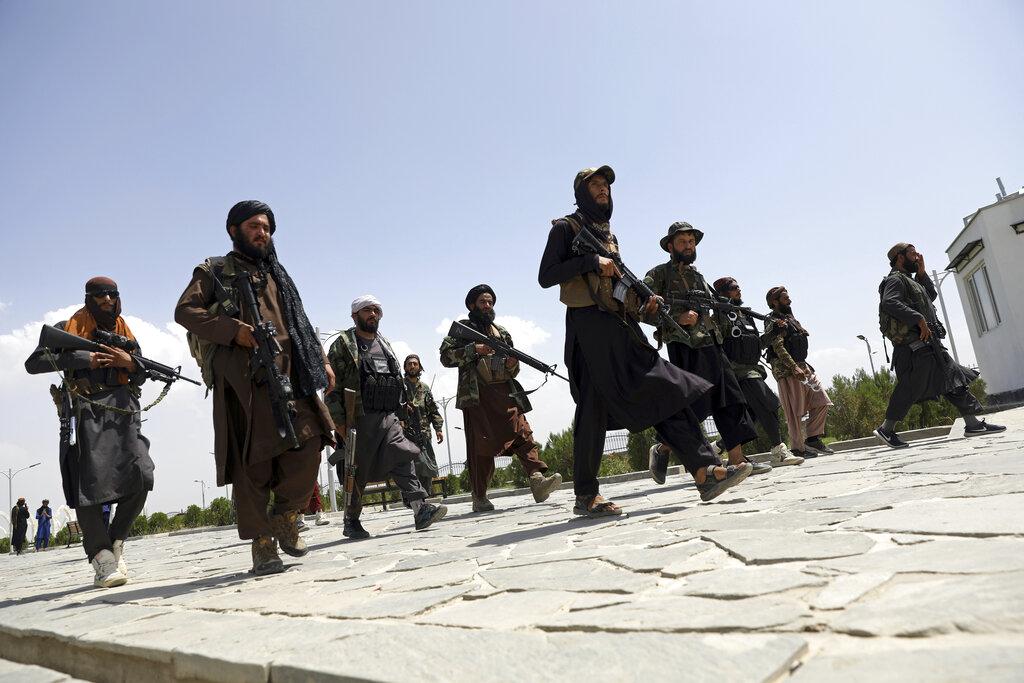 In this Aug. 19, 2021, file photo, Taliban fighters patrol in Kabul, Afghanistan. (AP Photo/Rahmat Gul, File)