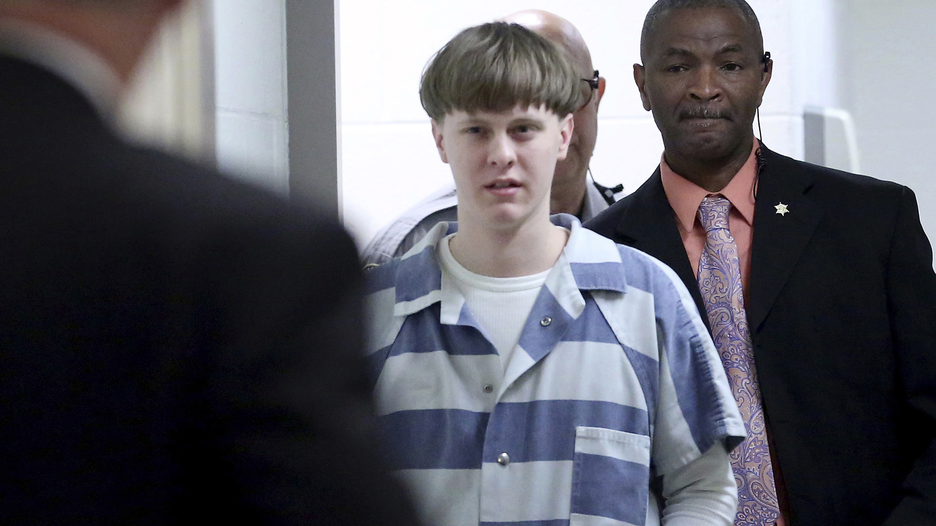 In this April 10, 2017, file photo, Dylann Roof enters the courtroom at the Charleston County Judicial Center to enter his guilty plea on murder charges in Charleston, S.C. (Grace Beahm/The Post And Courier via Associated Press, Pool)