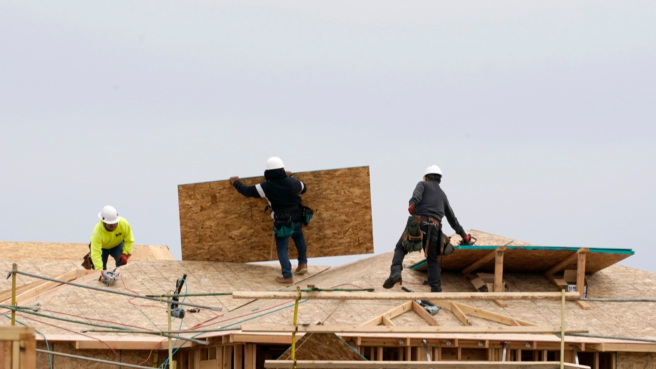 In this Feb. 11, 2021, file photo, work is done on a house under construction in Sacramento, Calif. (AP Photo/Rich Pedroncelli, File)