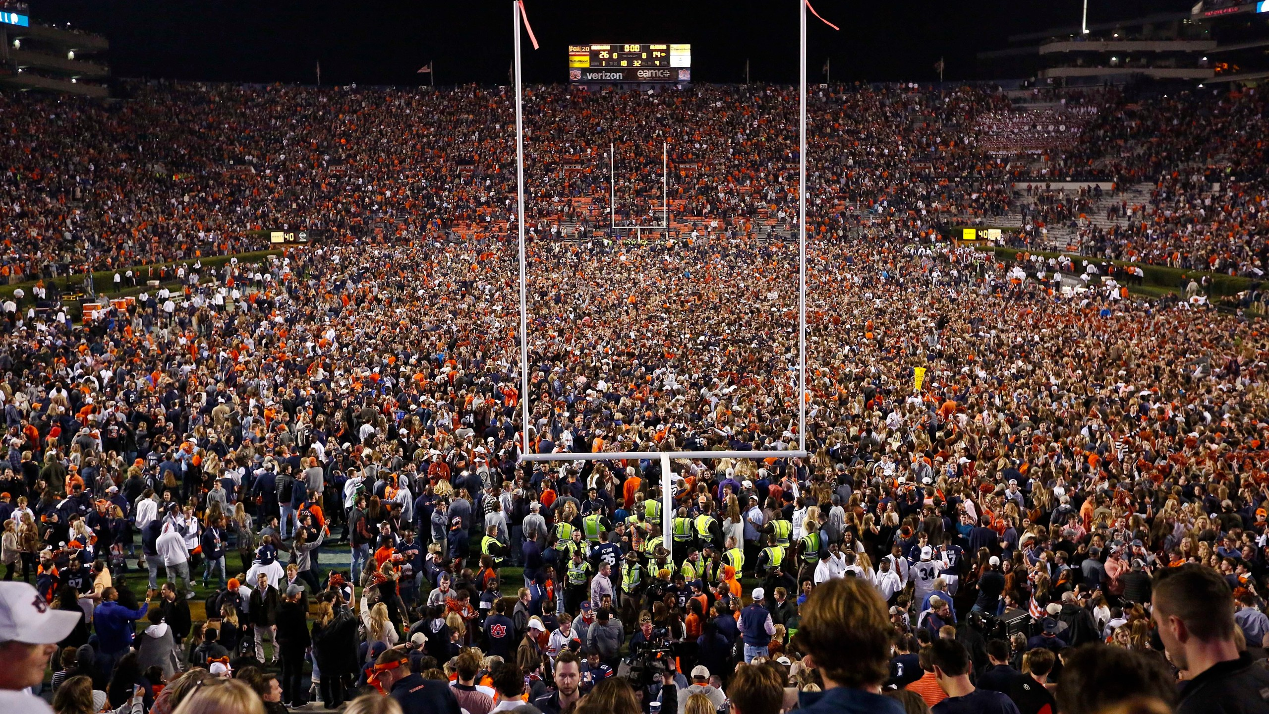 Fans rush the field after Auburn defeated Alabama in the Iron Bowl NCAA college football game, Saturday, Nov. 25, 2017, in Auburn, Ala. (AP Photo/Brynn Anderson, File)