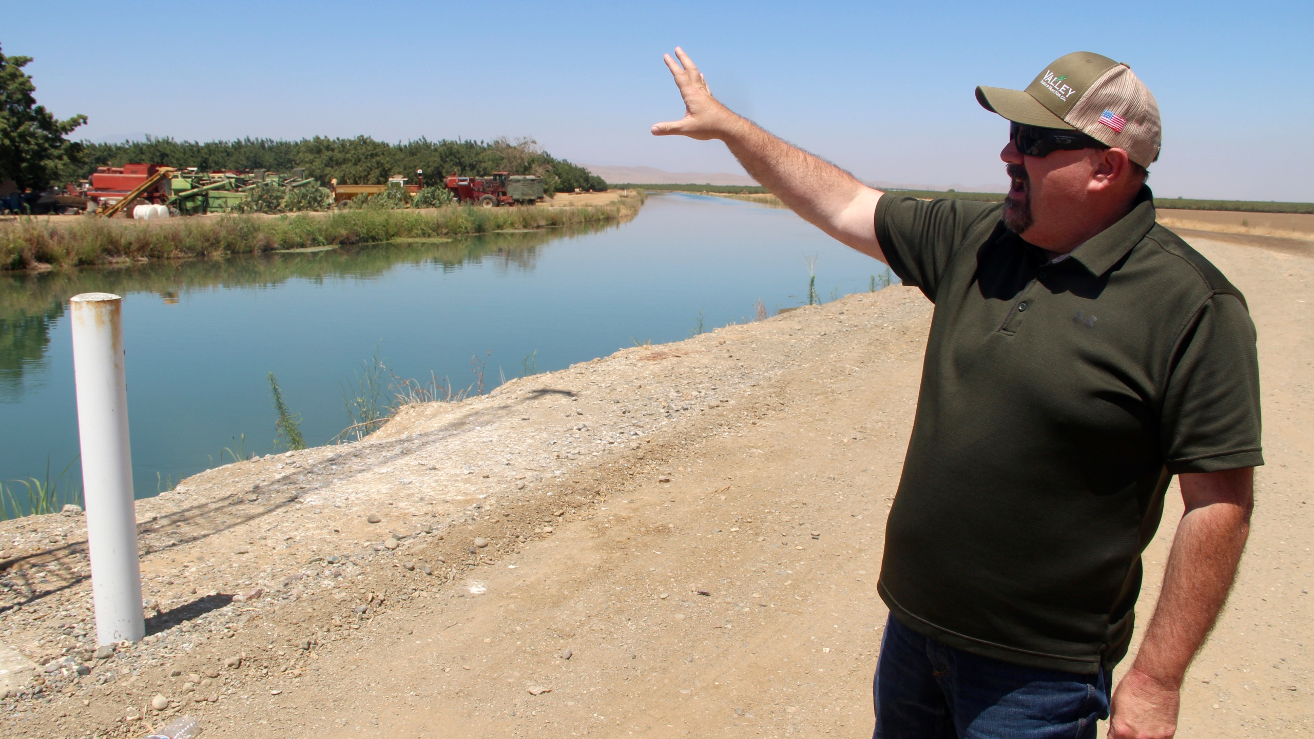 Kevin Spesert, public affairs and real estate manager for the Sites Project Authority, points out the main canal of the Glenn Colusa Irrigation District, on Friday, July 23, 2021, near Sites, Calif. The canal would be one of the primary sources of water for the planned Sites Reservoir, a project that would be large enough to supply enough water for 1.5 million households each for one year.(AP Photo/Adam Beam)