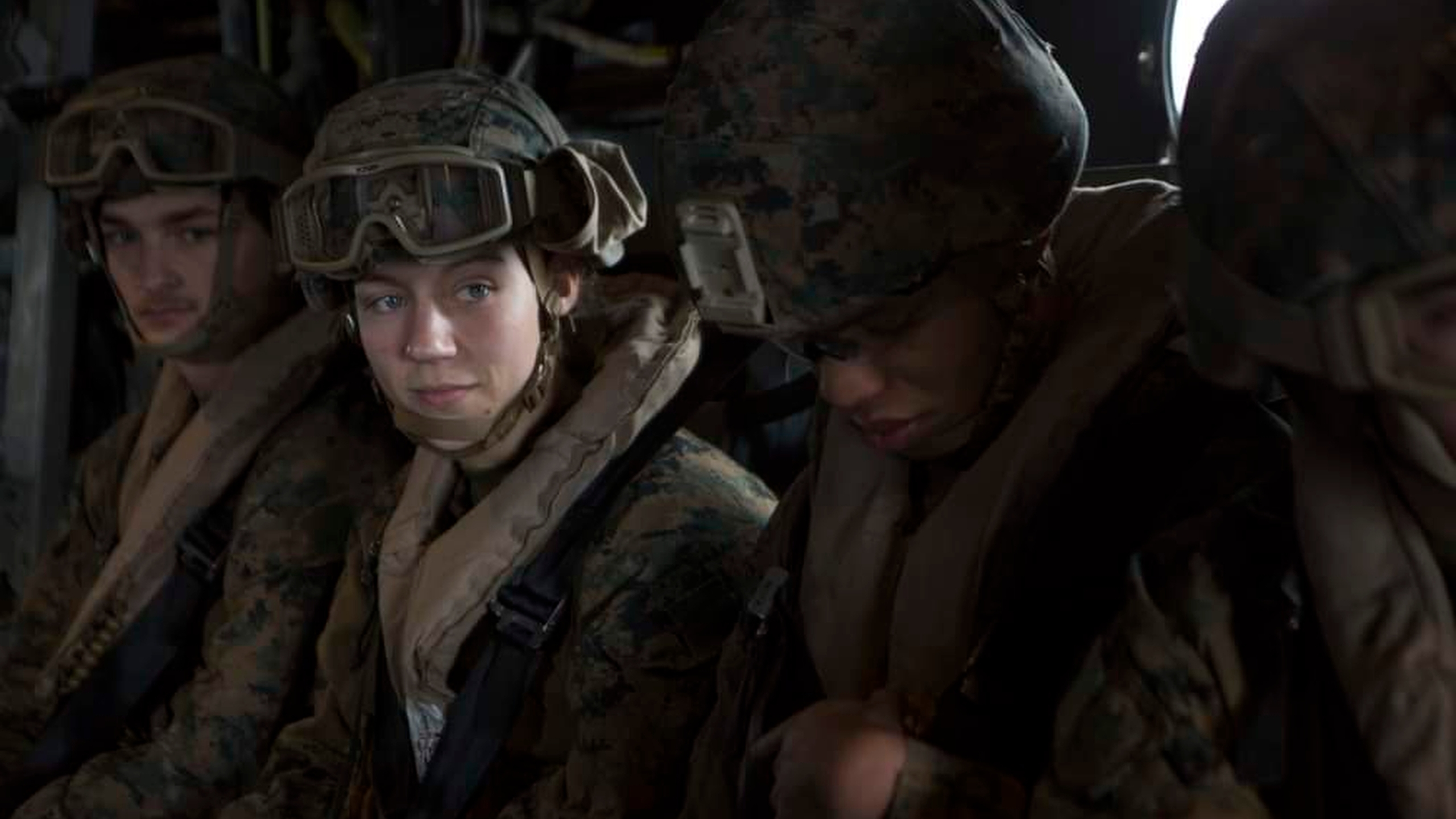 This Aug. 26, 2021, photo, released by U.S. Marine Corps/II Marine Expeditionary Force, shows U.S. Marine Corps Sgt. Nicole L. Gee, second from left, while supporting evacuation operations in Kabul, Kabul Province, Afghanistan. Sgt. Gee died following an attack near the Hamid Karzai International Airport in Kabul. Gee, 23, of Sacramento, California, was a maintenance technician with the 24th Marine Expeditionary Unit from Camp Lejeune in North Carolina. (U.S. Marine Corps/II Marine Expeditionary Force via AP)