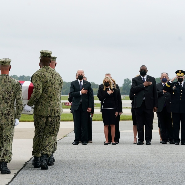 President Joe Biden watches as a Navy carry team moves a transfer case containing the remains of Navy Corpsman Maxton W. Soviak, 22, of Berlin Heights, Ohio, Sunday, Aug. 29, 2021, at Dover Air Force Base, Del. According to the Department of Defense, Soviak died in an attack at Afghanistan's Kabul airport, along with 12 other U.S. service members supporting Operation Freedom's Sentinel. From left, President Joe Biden, first lady Jill Biden, Secretary of Defense Lloyd Austin, and Joint Chiefs Chairman Gen. Mark Milley.(AP Photo/Manuel Balce Ceneta)