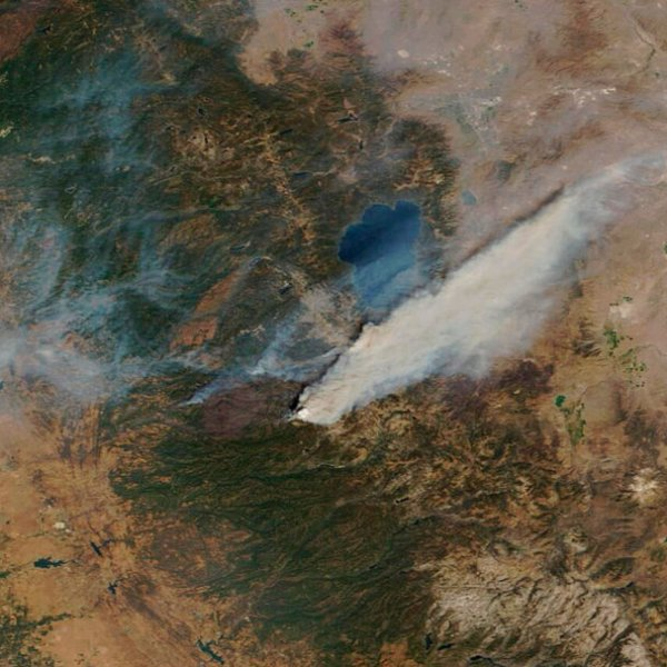 This Sunday, Aug. 29, 2021, image provided by Maxar Technologies, shows a Moderate Resolution Imaging Spectroradiometer (MODIS), a true-color image overview of the wildfires at Lake Tahoe, in South Lake Tahoe, Calif. (Satellite image ©2021 Maxar Technologies via AP)