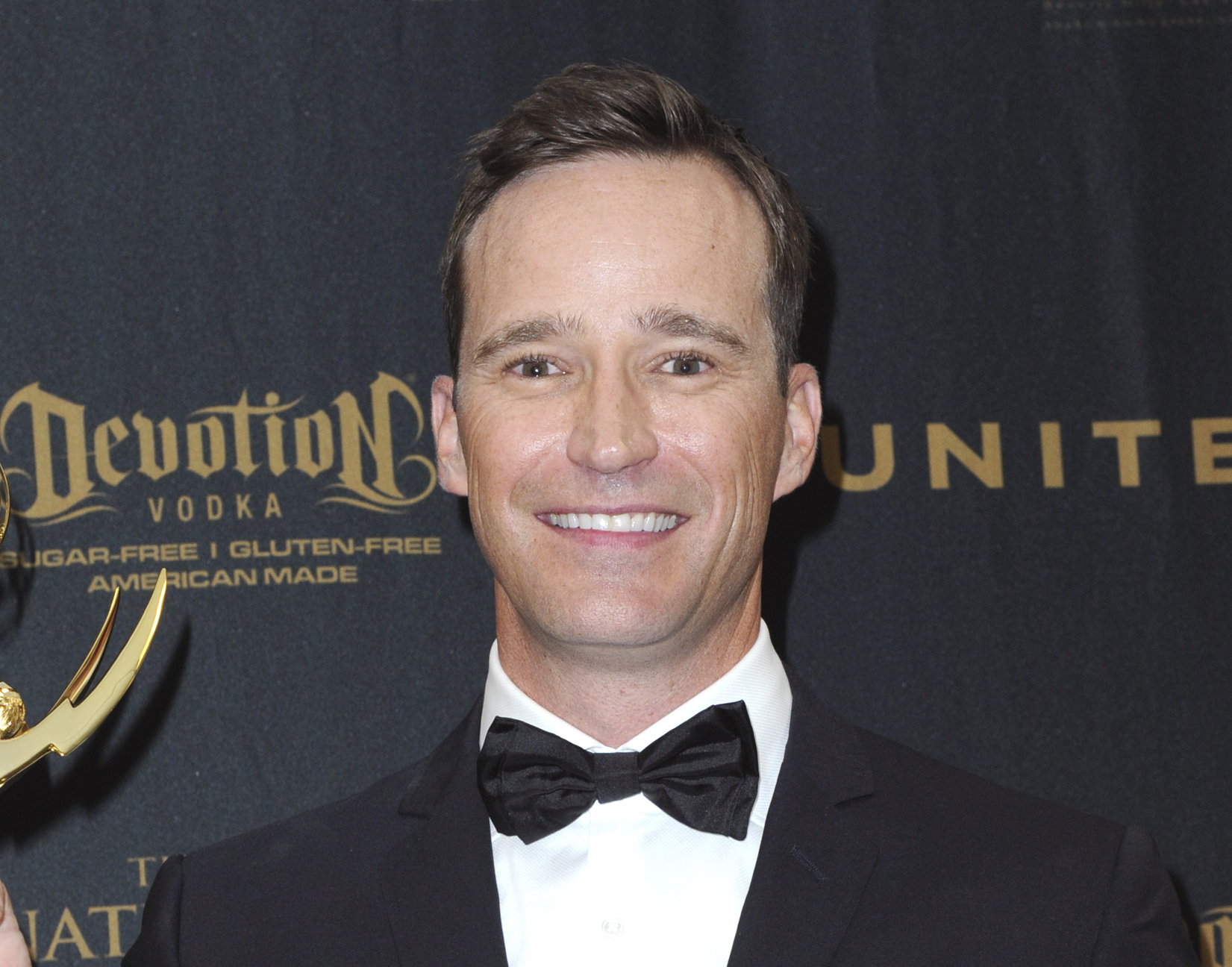 """Producer Mike Richards poses in the pressroom at the 43rd annual Daytime Emmy Awards on May 1, 2016, in Los Angeles. Richards is out as executive producer of """"Jeopardy!"""", days after he exited as the quiz show's newly appointed host because of past misogynistic and other comments. Richards is also no longer executive producer of """"Wheel of Fortune."""" (Photo by Richard Shotwell/Invision/AP, File)"""