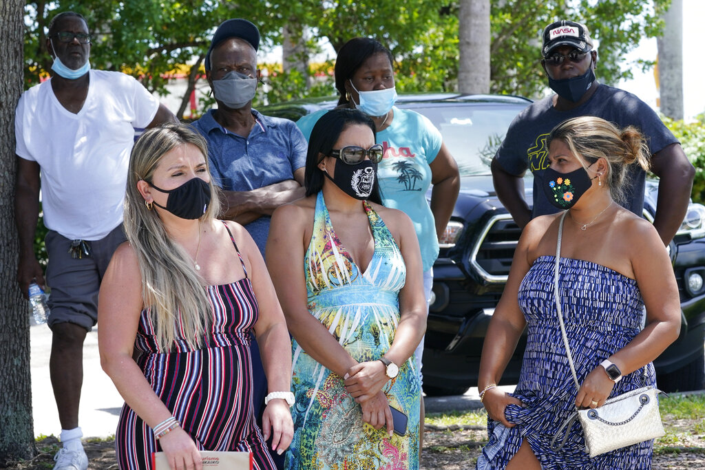 A group waits to get a COVID-19 test in North Miami, Fla. The state has become the new national epicenter for the virus, accounting for around a fifth of all new cases in the U.S. Florida Gov. Ron DeSantis has resisted mandatory mask mandates and vaccine. (AP Photo/Marta Lavandier)