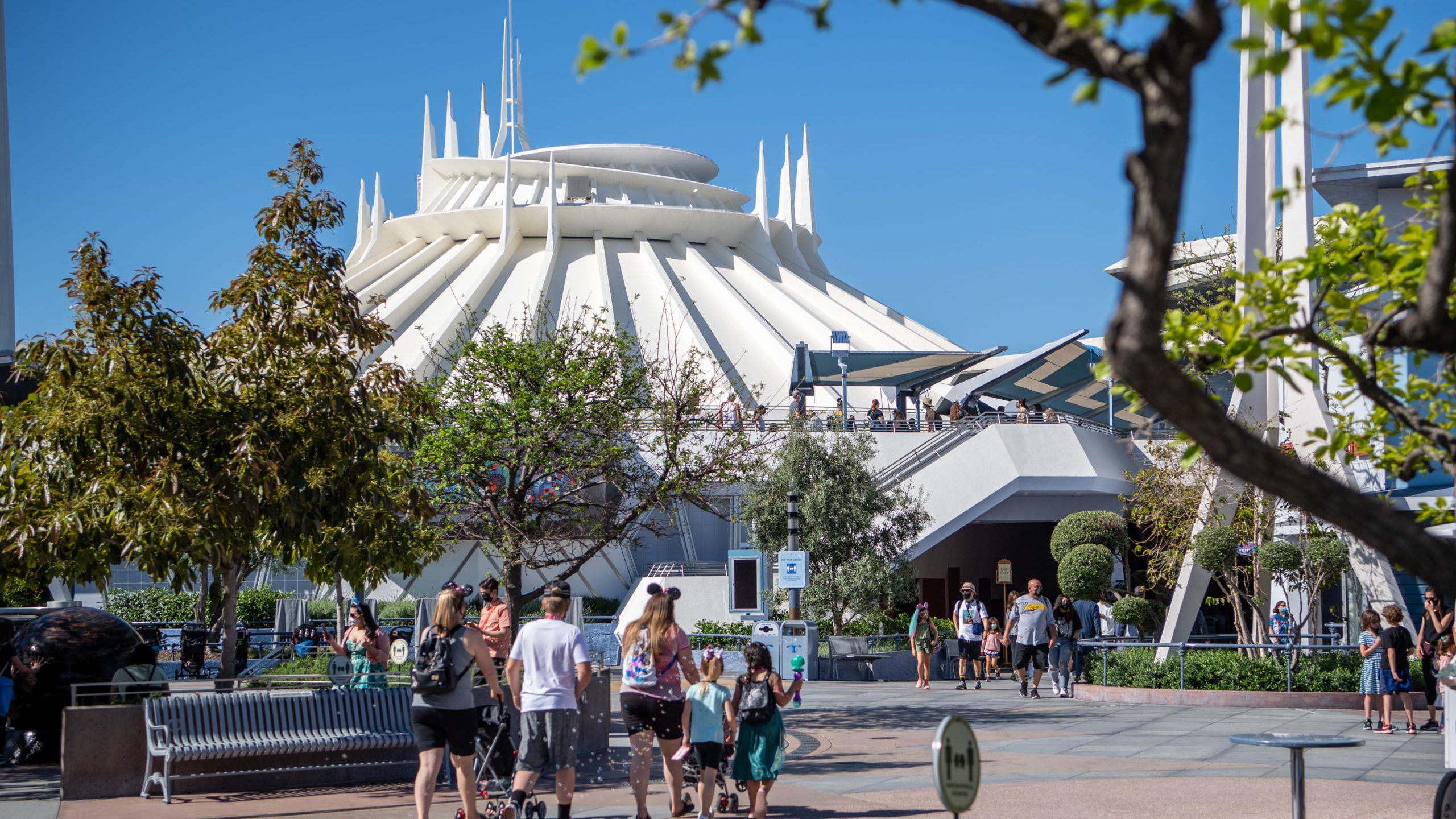 In this handout photo, guests arrive in Tomorrowland at the Disneyland Resort on April 30, 2021, in Anaheim. (Richard Harbaugh/Disneyland Resort via Getty Images)