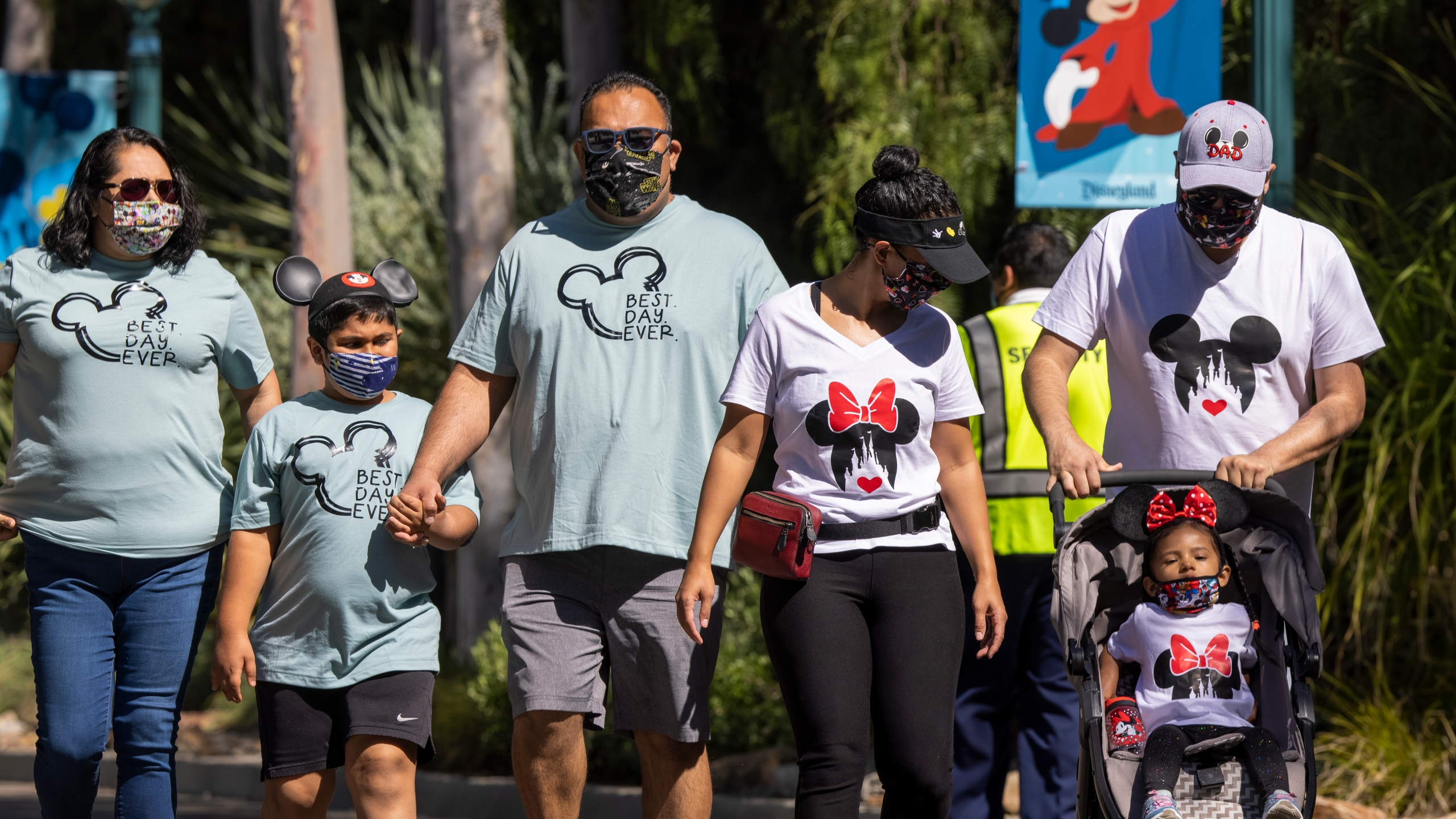People enter Disneyland Park as it reopens on April 30, 2021, for the first time since the COVID-19 pandemic forced the park to shut down. (David McNew / Getty Images)
