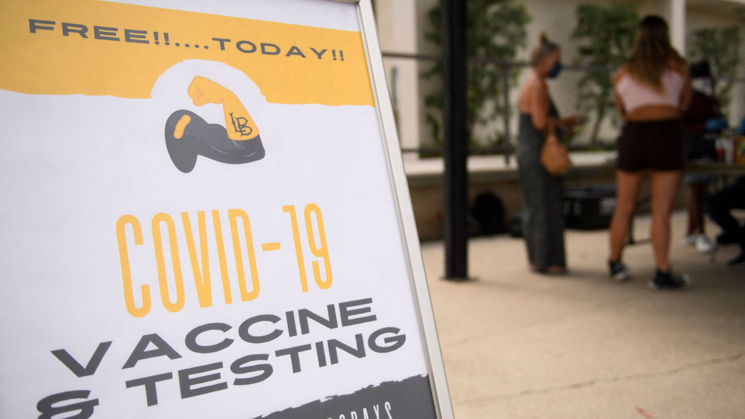 Free COVID-19 vaccine and testing signage is displayed during a City of Long Beach Public Health Covid-19 mobile vaccination clinic at the California State University Long Beach campus on Aug. 11, 2021 in Long Beach. (PATRICK T. FALLON/AFP via Getty Images)