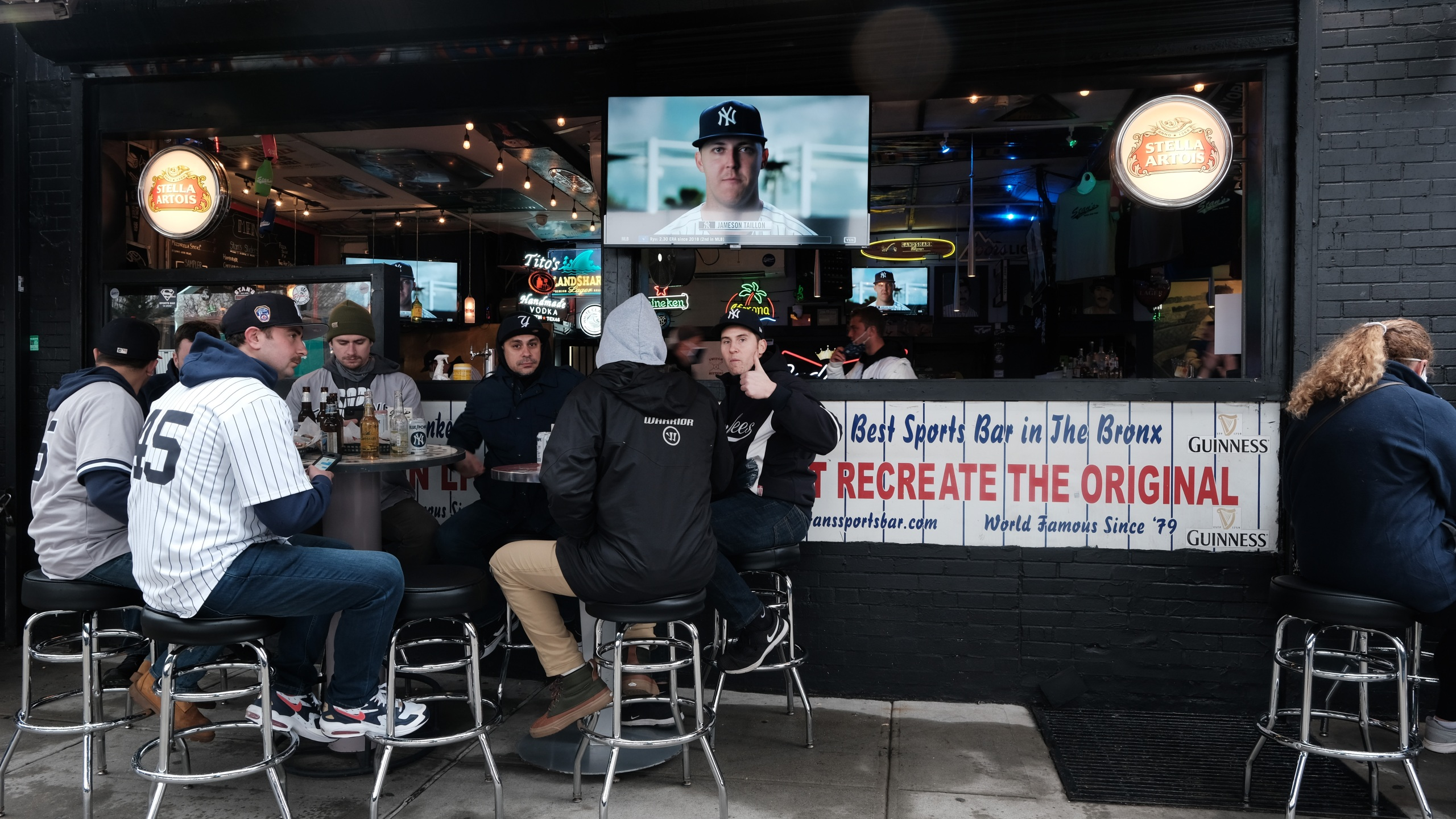 People gather at restaurants and bars outside of Yankee Stadium in the Bronx for the Opening Day of baseball season on April 1, 2021 in New York City. (Spencer Platt/Getty Images)