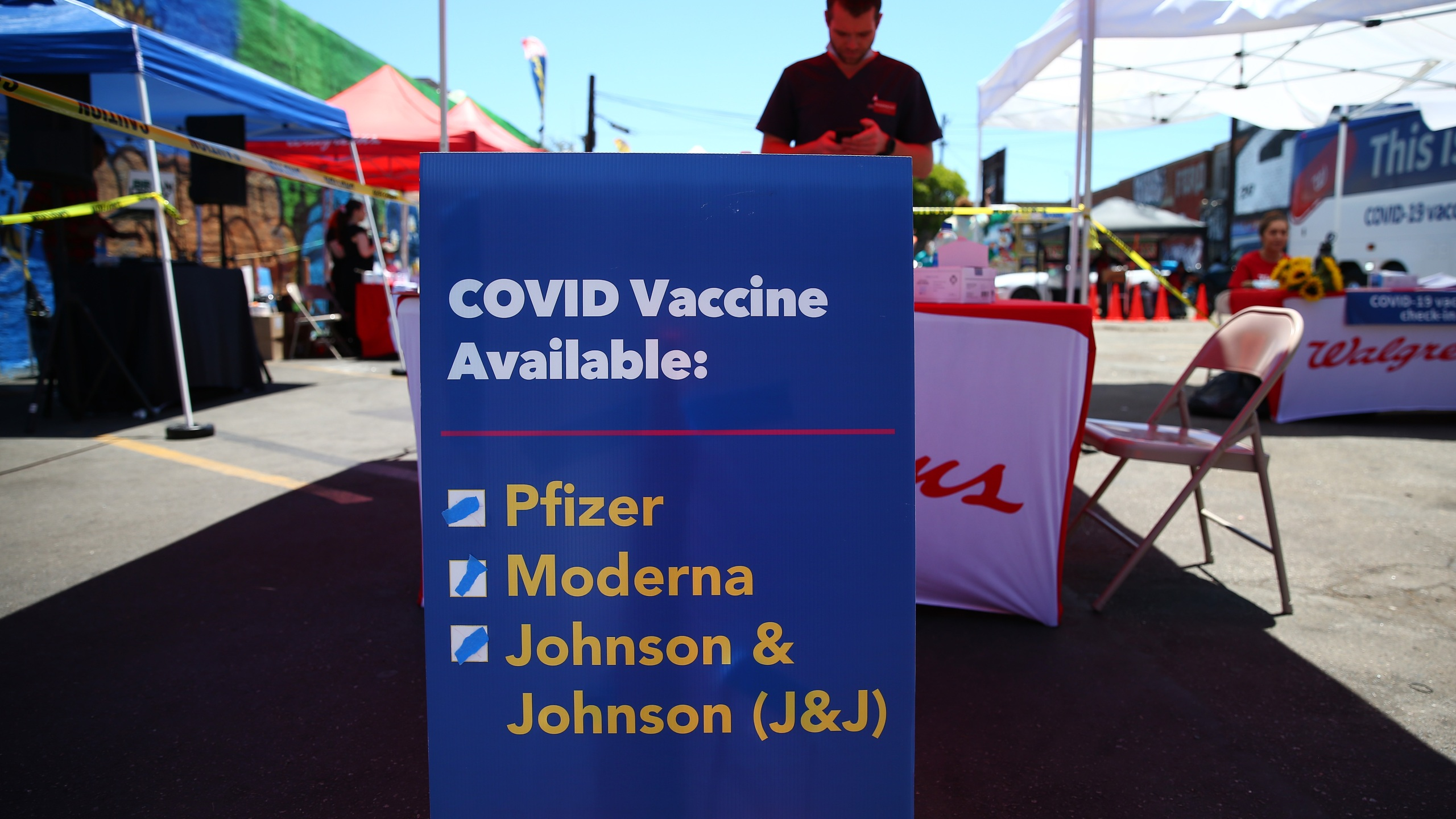 A sign displays the types of COVID-19 vaccination doses available at a Walgreens mobile bus clinic on June 25, 2021 in Los Angeles. (Mario Tama/Getty Images)