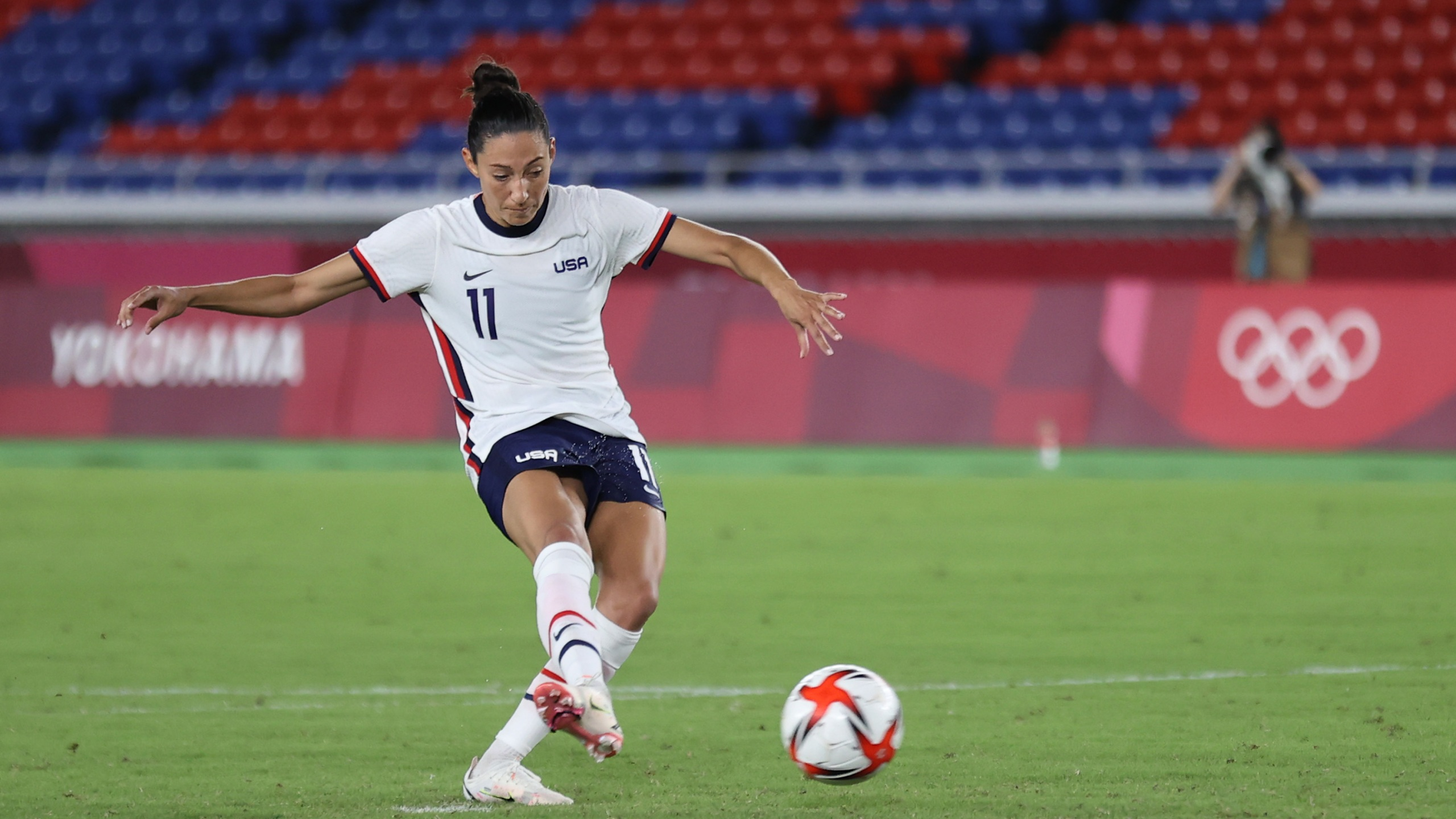 Christen Press of Team United States scores their team's third penalty in the penalty shoot out during the Women's Quarter Final match between Netherlands and United States on day seven of the Tokyo 2020 Olympic Games at International Stadium in Yokohama on July 30, 2021. (Griffiths/Getty Images)