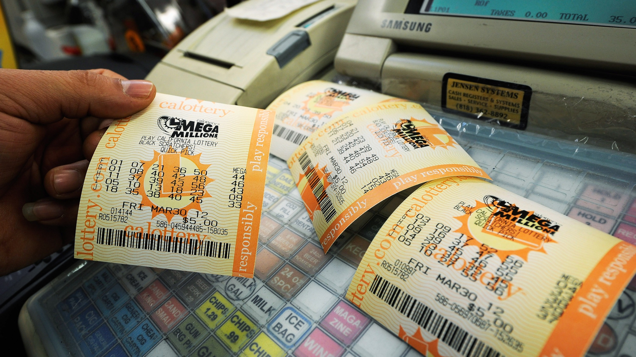 In this file photo, Mega Millions lottery tickets sit on a register at Liquorland on March 30, 2012 in Covina. (Kevork Djansezian/Getty Images)