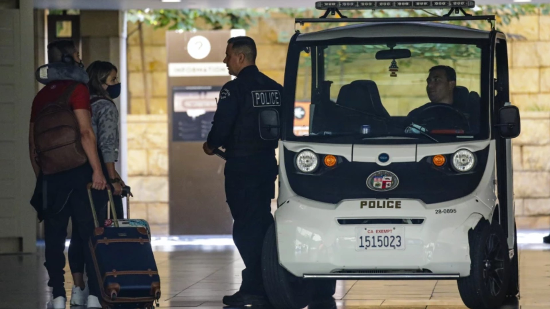 Unmasked LAPD officers patrol Union Station on Aug. 11. (Irfan Khan / Los Angeles Times)