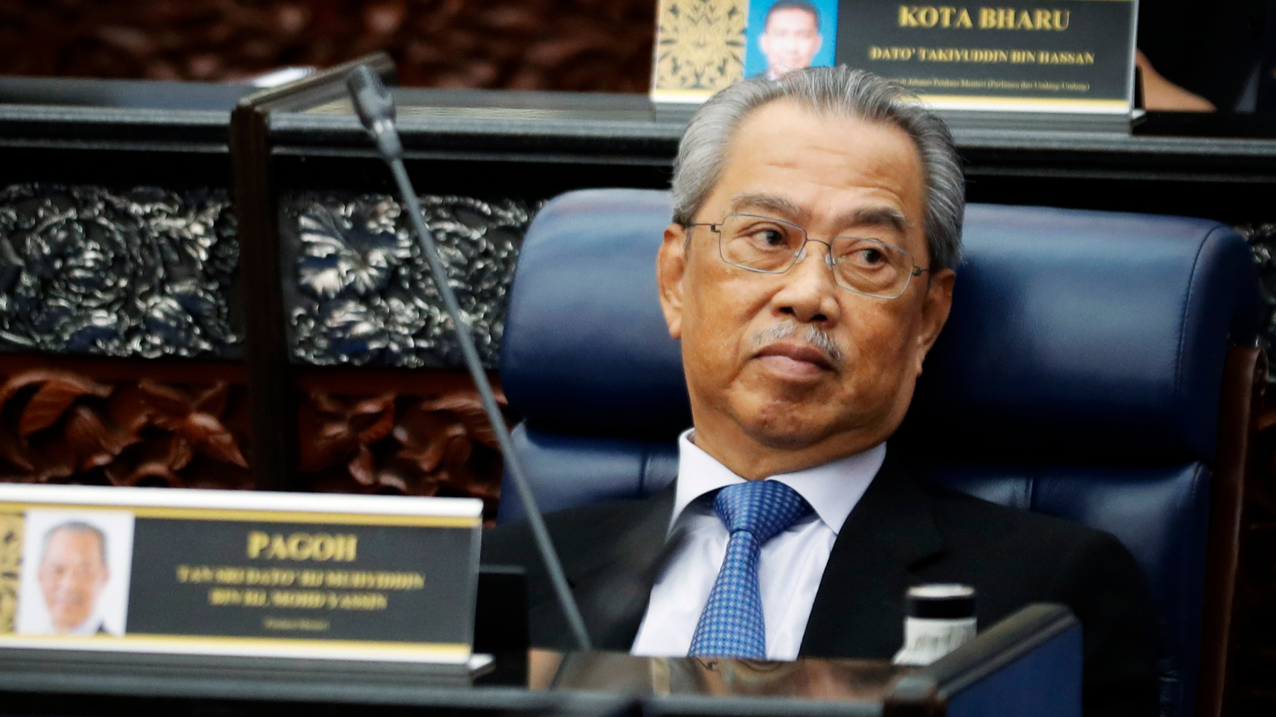 In this July 13, 2020, photo, Malaysian Prime Minister Muhyiddin Yassin attends a Parliament session at lower house in Kuala Lumpur, Malaysia. (AP Photo/Vincent Thian)