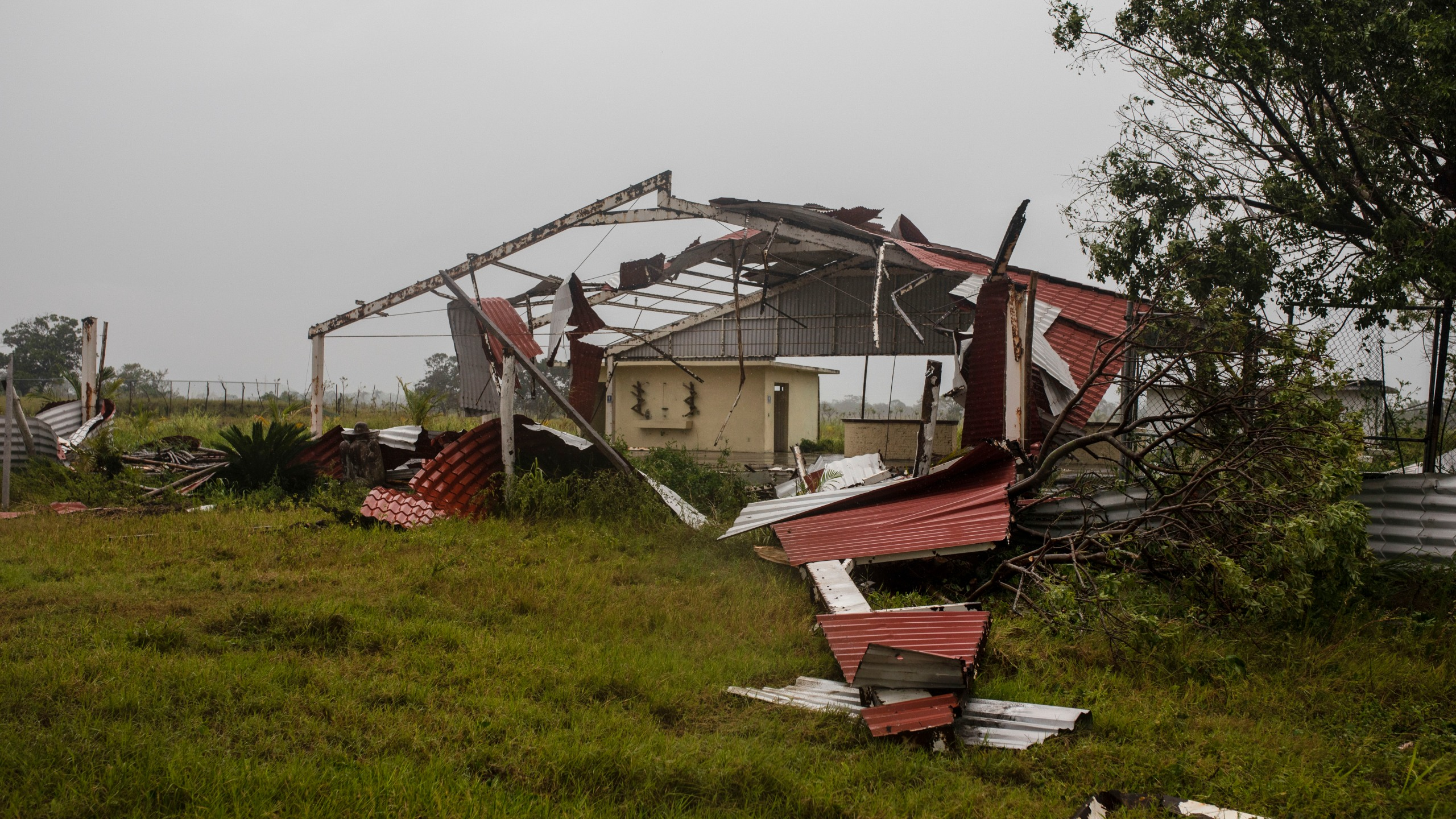 Pieces of roof lay on the ground in the aftermath of Hurricane Grace, in Tecolutla, Veracruz State, Mexico, Saturday, Aug. 21, 2021. (AP Photo/Felix Marquez)