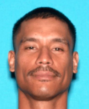 Ervin Olikong is shown in a photo released by the San Bernardino Police Department on Aug. 19, 2021.