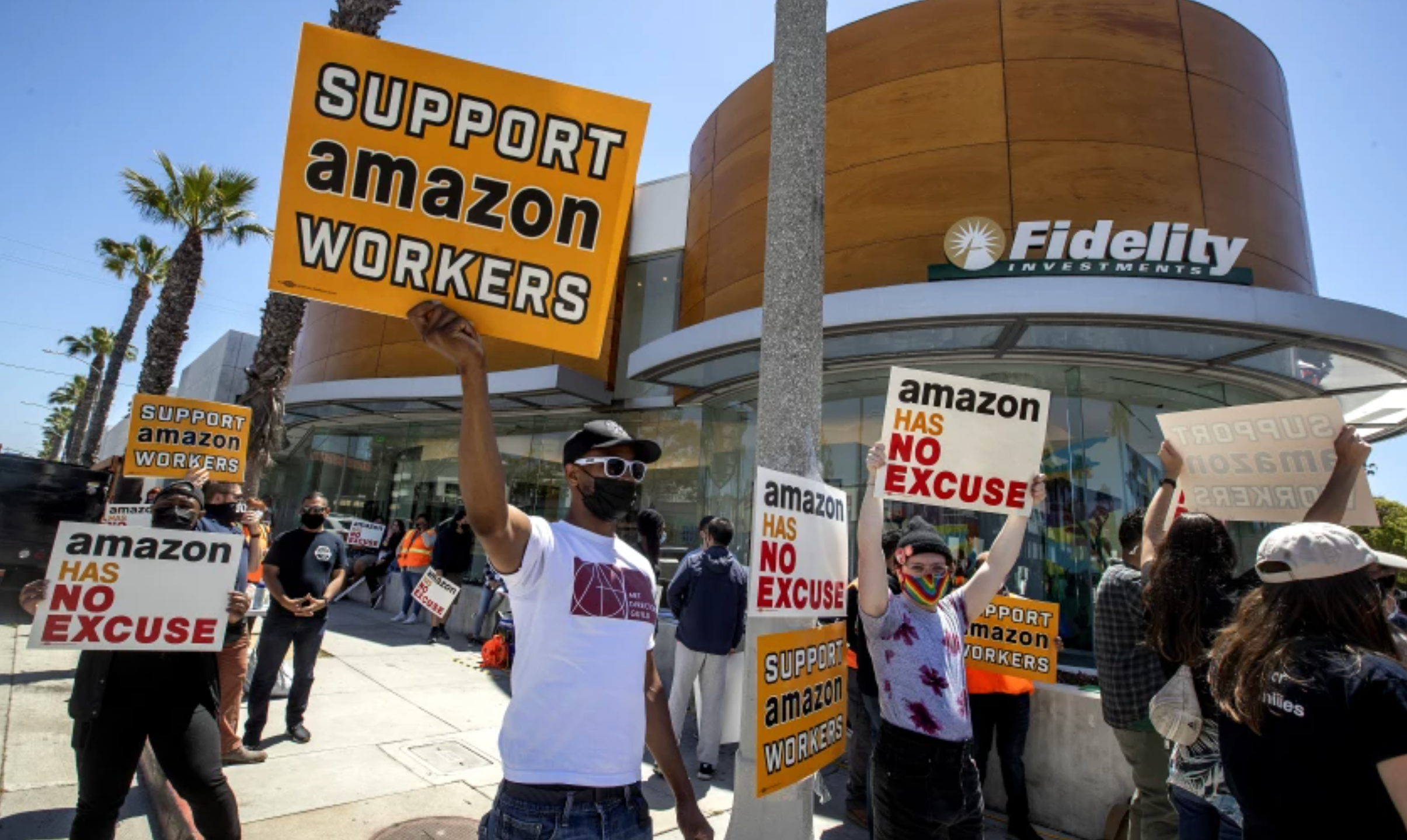 Union activists and other supporters of Amazon workers protested in May outside Fidelity Investments, one of Amazon's largest shareholders, in Santa Monica. Activists want Amazon to be more accountable to workers, who too frequently get injured on the job. (Mel Melcon / Los Angeles Times)