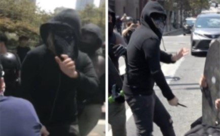 Police think a black-clad man stabbed another man at a protest on Aug. 14, 2021. (LAPD)