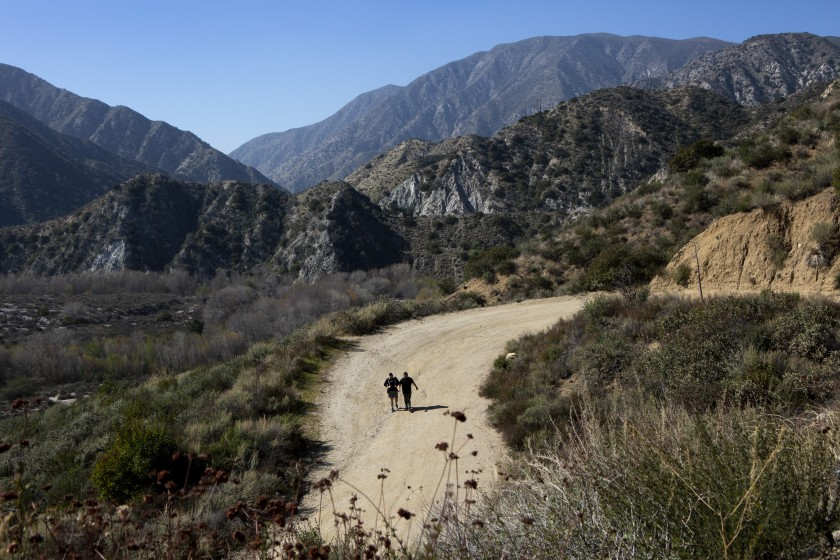 A pair is seen hiking the Trail Canyon Falls trail in Angeles National Forest in this undated file photo. (Gabriella Angotti-Jones / Los Angeles Times)