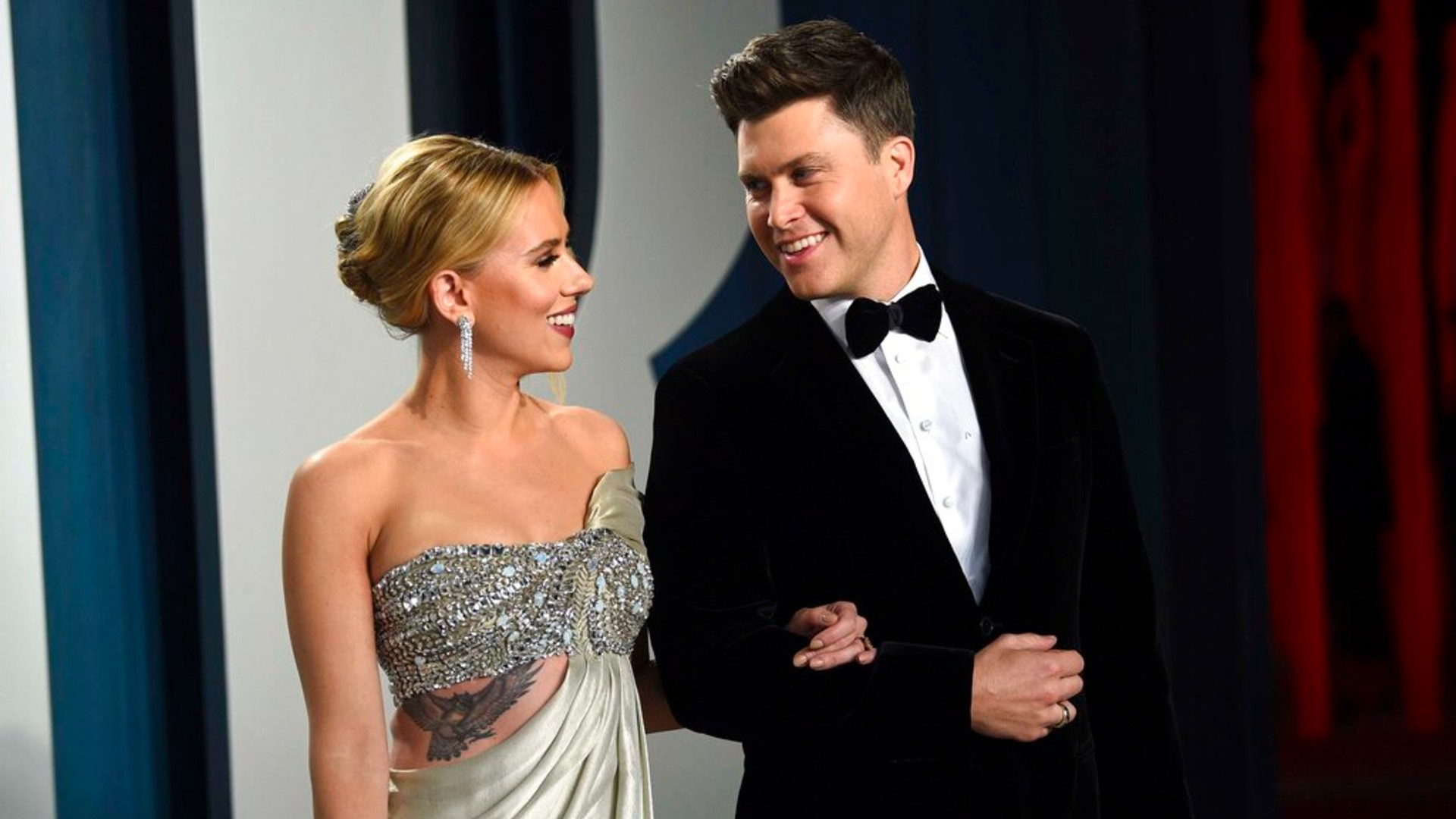 In this Feb. 9, 2020 file photo, Scarlett Johansson, left, and Colin Jost arrive at the Vanity Fair Oscar Party in Beverly Hills, Calif. (Photo by Evan Agostini/Invision/AP, File)