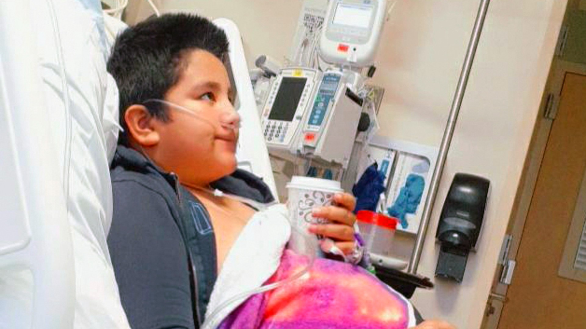 This 2021 photo provided by Yessica Gonzalez shows her son, Francisco Rosales, 9, in the intensive care unit at Children's Medical Center in Dallas, Texas. The day before he was supposed to start fourth grade, Francisco was admitted to the hospital due to severe COVID-19, struggling to breathe, with dangerously low oxygen levels and an uncertain outcome. (Yessica Gonzalez via AP)