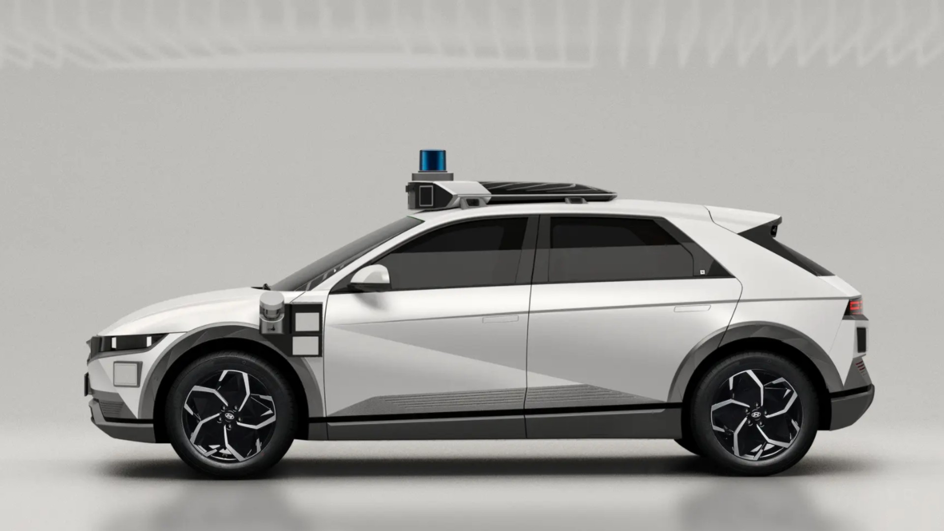 An image of a Motional robotaxi, built on a Hyundai Ioniq 5 motor vehicle platform. A lidar sensor system sits atop the car.(Motional)