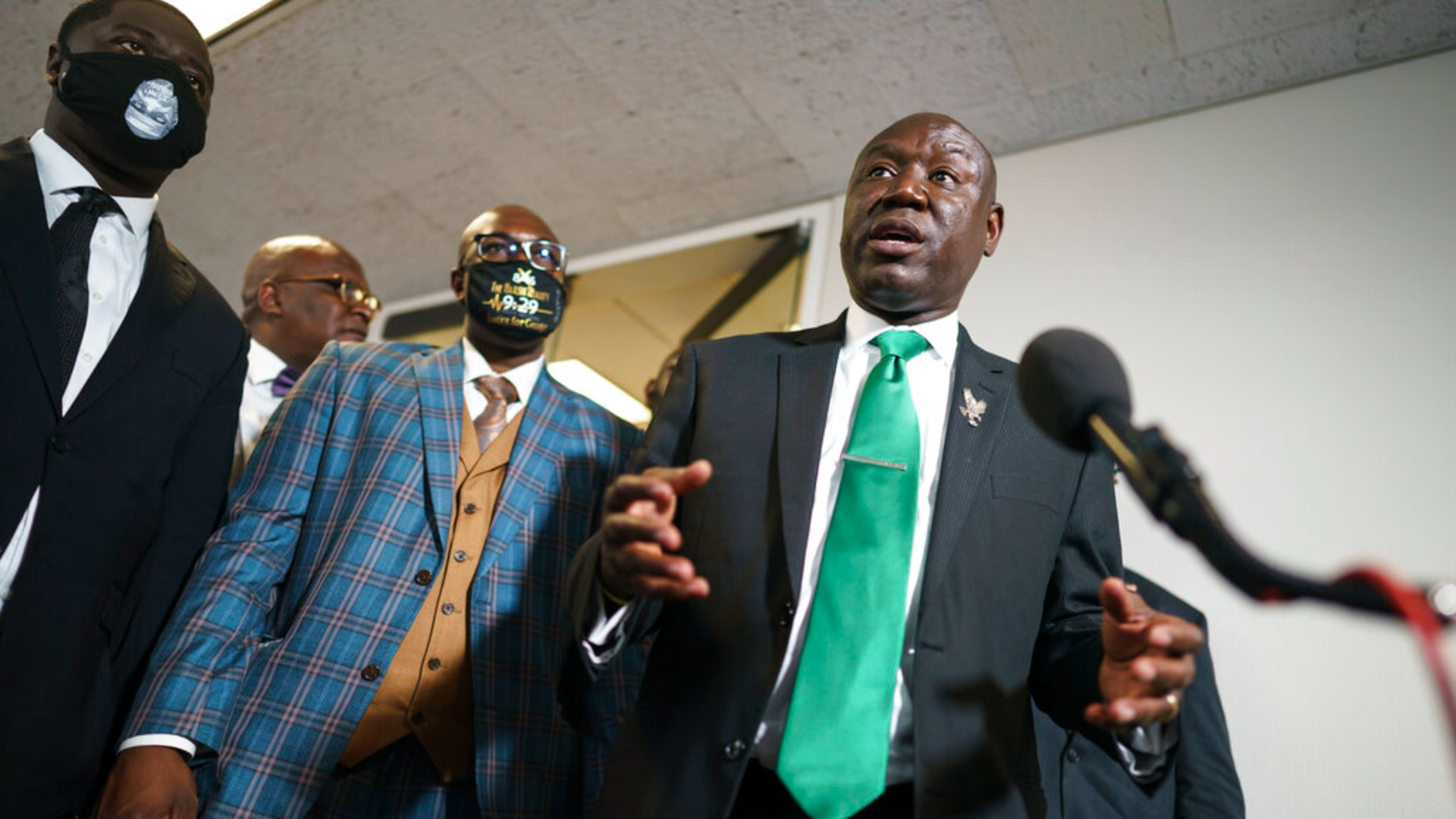 In this May 25, 2021, file photo, Ben Crump, center, the civil rights attorney representing the family of George Floyd, speaks to reporters after they met with Sen. Cory Booker, D-N.J., about police reform legislation, at the Capitol in Washington. (AP Photo/J. Scott Applewhite, File)