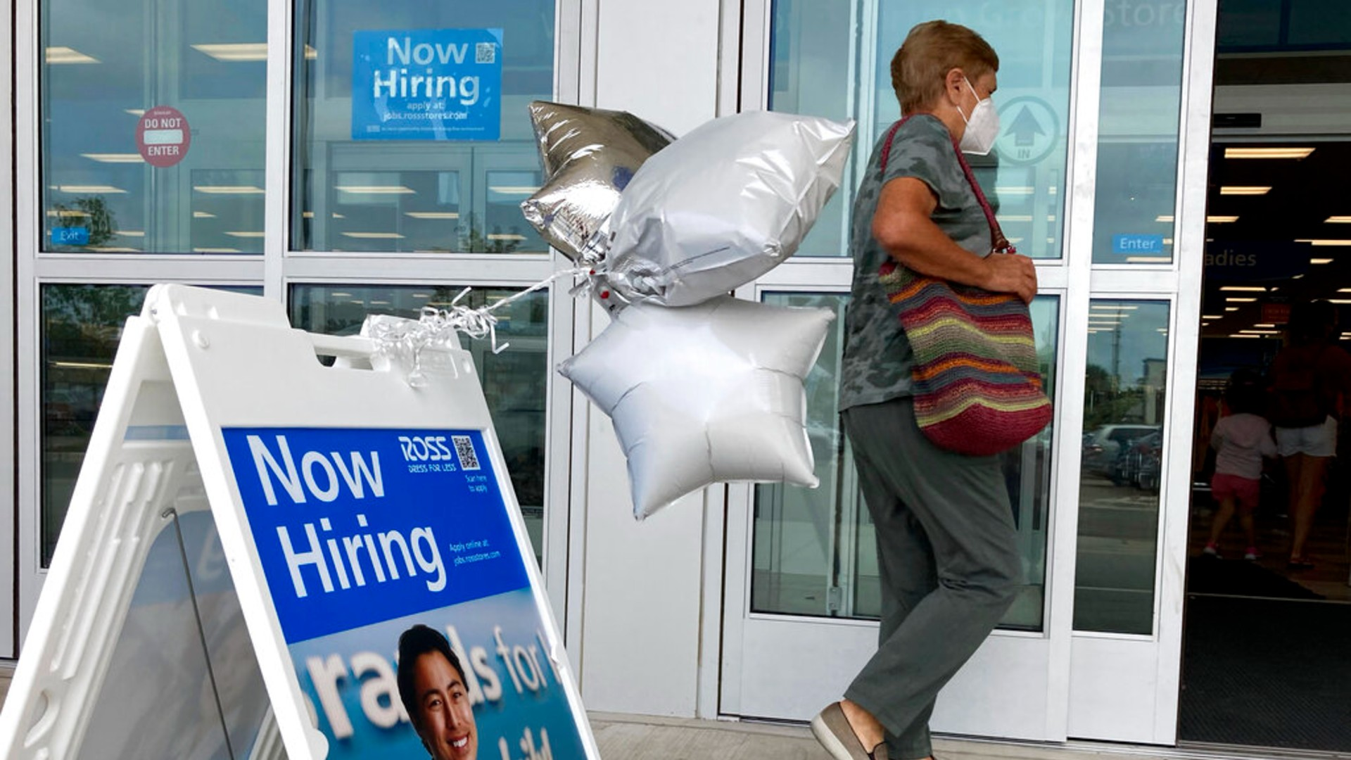 A shopper passes a hiring sign while entering a retail store in Morton Grove, Ill., Wednesday, July 21, 2021. (AP Photo/Nam Y. Huh)